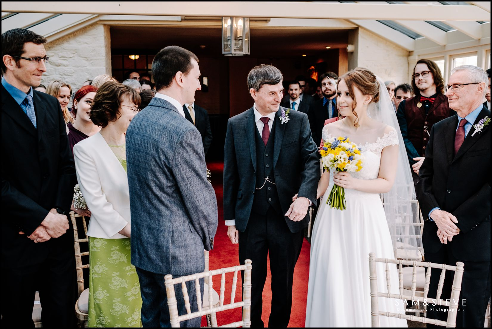 Bay Tree Burford wedding photography of a bride and her father approaching her groom