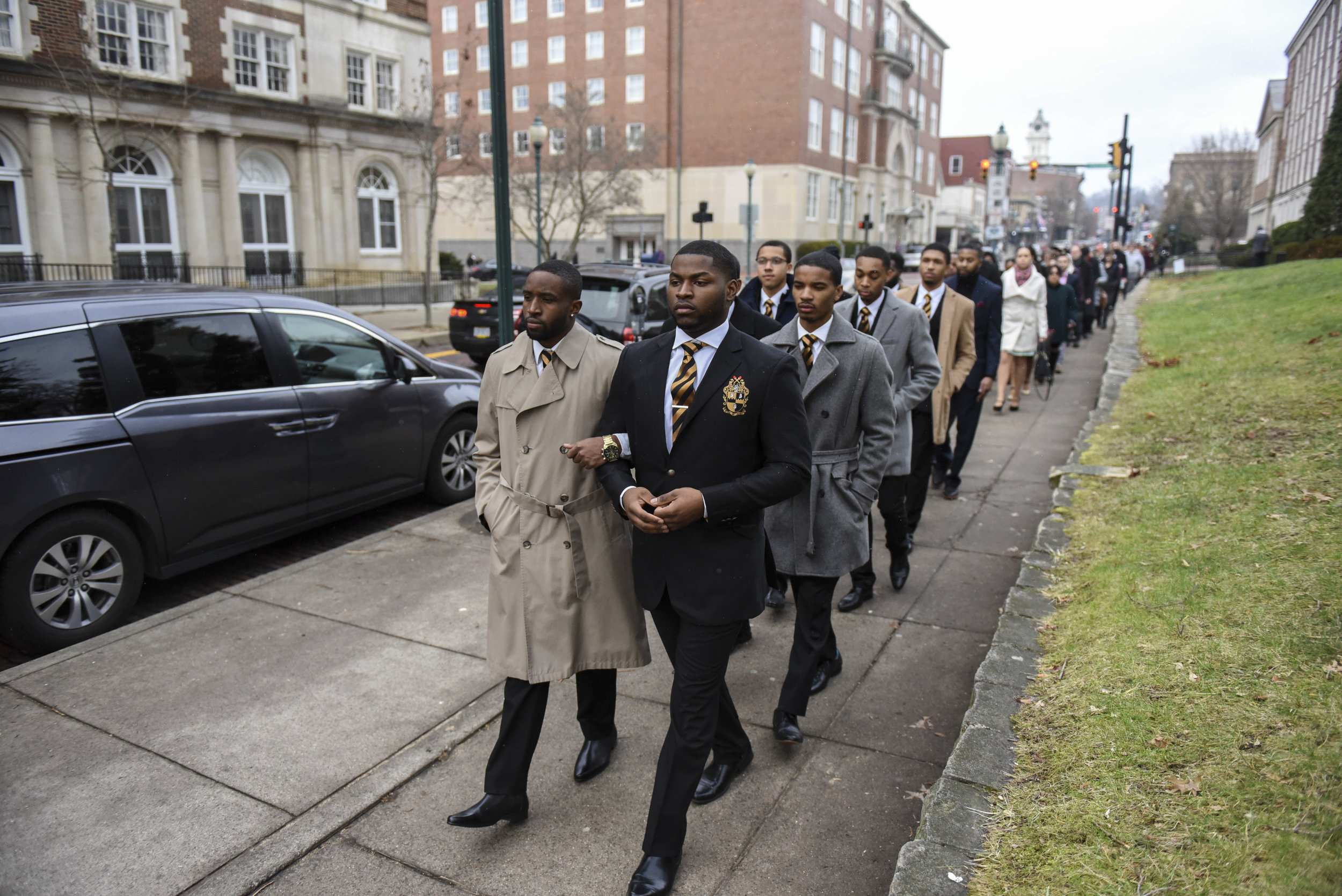 Elijah Cohen-Denison (left), Marquis Maines (right) and fellow members of Alpha Phi Alpha, a historically black fraternity at Ohio University, lead a silent march down Court Street in Athens, Ohio, in honor of Martin Luther King Jr. on Jan. 16, 2017. This is the 17th year that Alpha Phi Alpha has hosted this event.