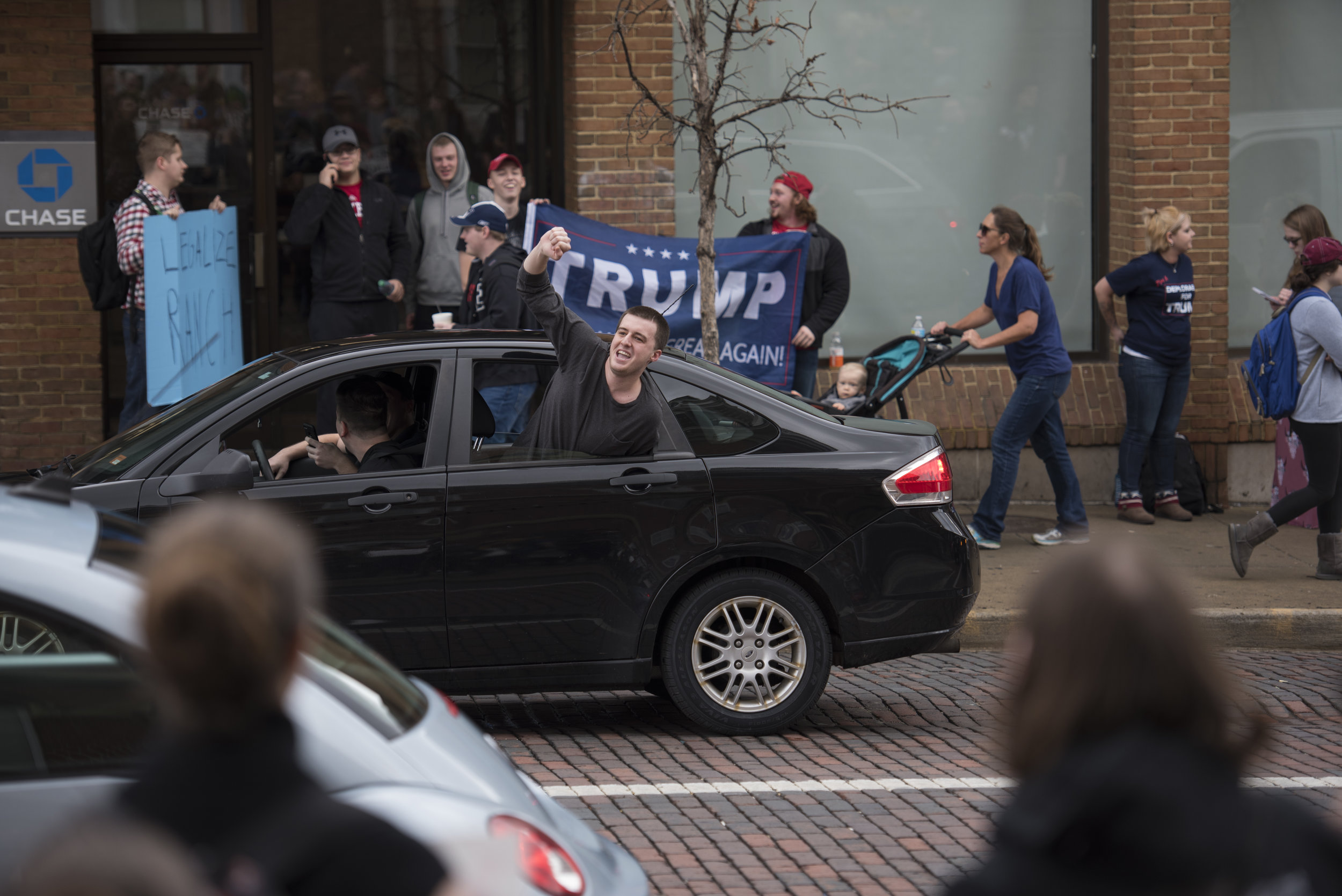 A Trump supporter yells out of a car window at a crowd of Trump protestors on Court Street on Jan. 20, 2017 in Athens, Ohio. The crowd had assembled in front of the courthouse after a walkout at Ohio University in protest of Donald Trump's inauguration. Shortly after, a smaller crowd of Trump supporters gathered across the street.