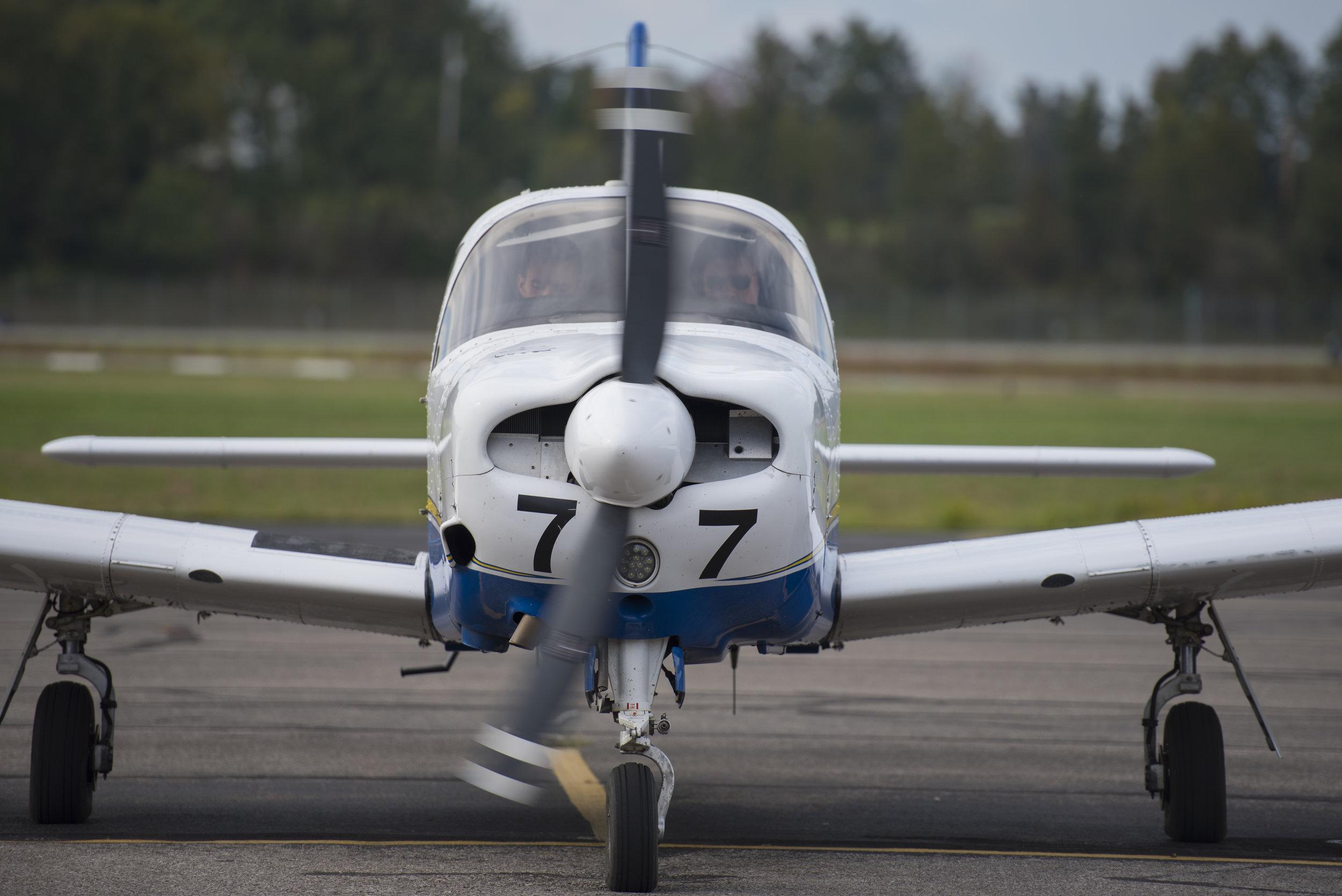 Ohio University senior Ryan Potter and flight instructor Garrett Bussa prepare for take off on Sept. 20, 2017.