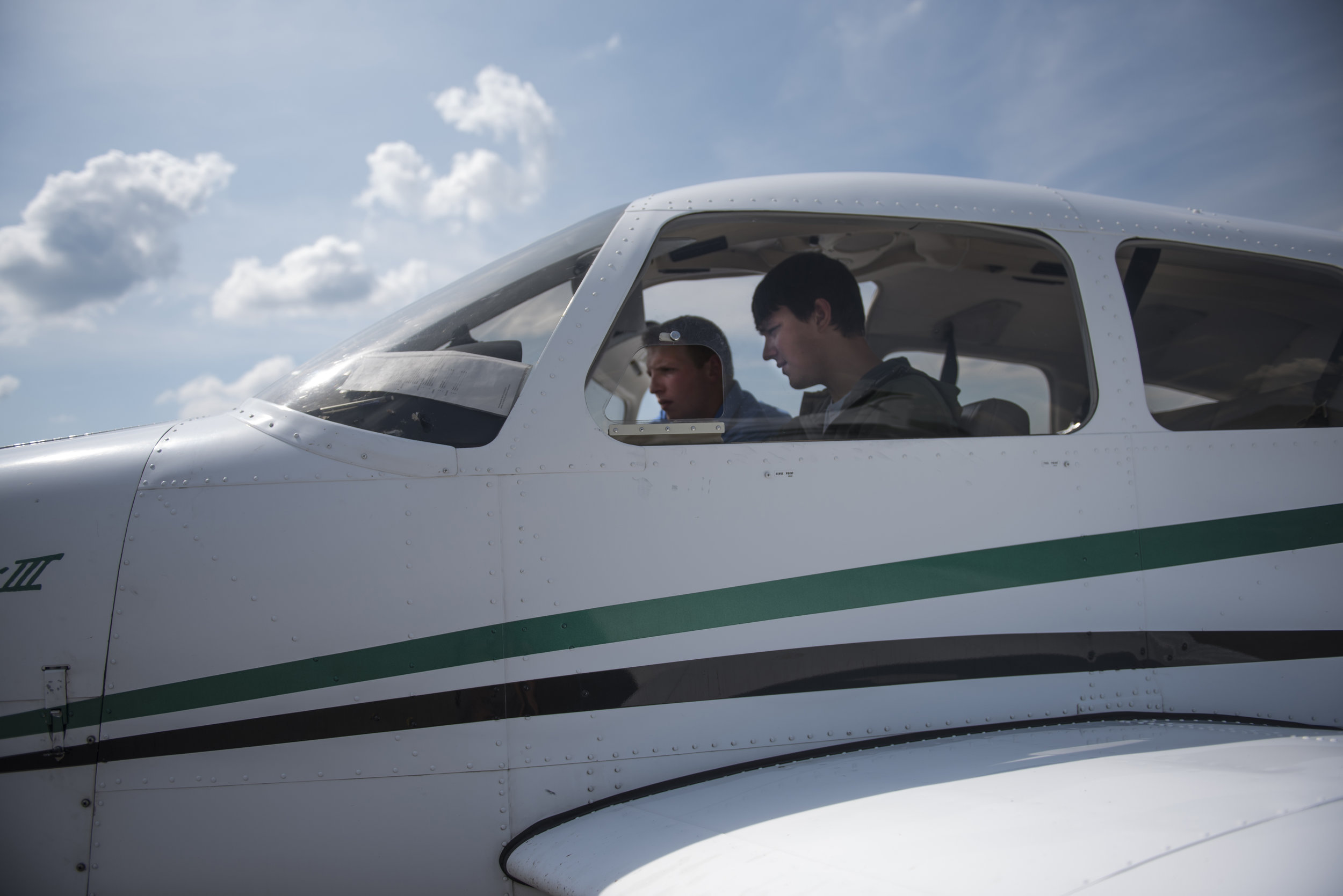Flight instructor Michael Popo (left) gives Ohio University junior aviation major Henry Baxter-Potter (right) a lesson in one of Ohio University's small planes on Sept. 18, 2017.