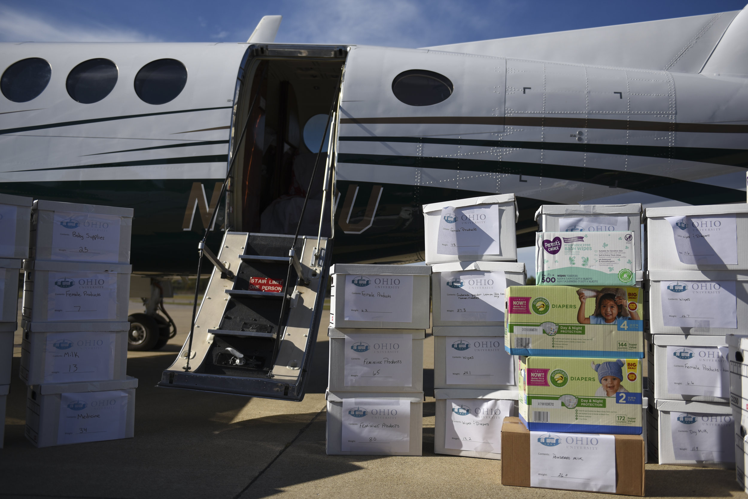 Boxes filled with donations wait to be loaded onto the Ohio University King Air airplane to be delivered to hurricane victims in Puerto Rico.