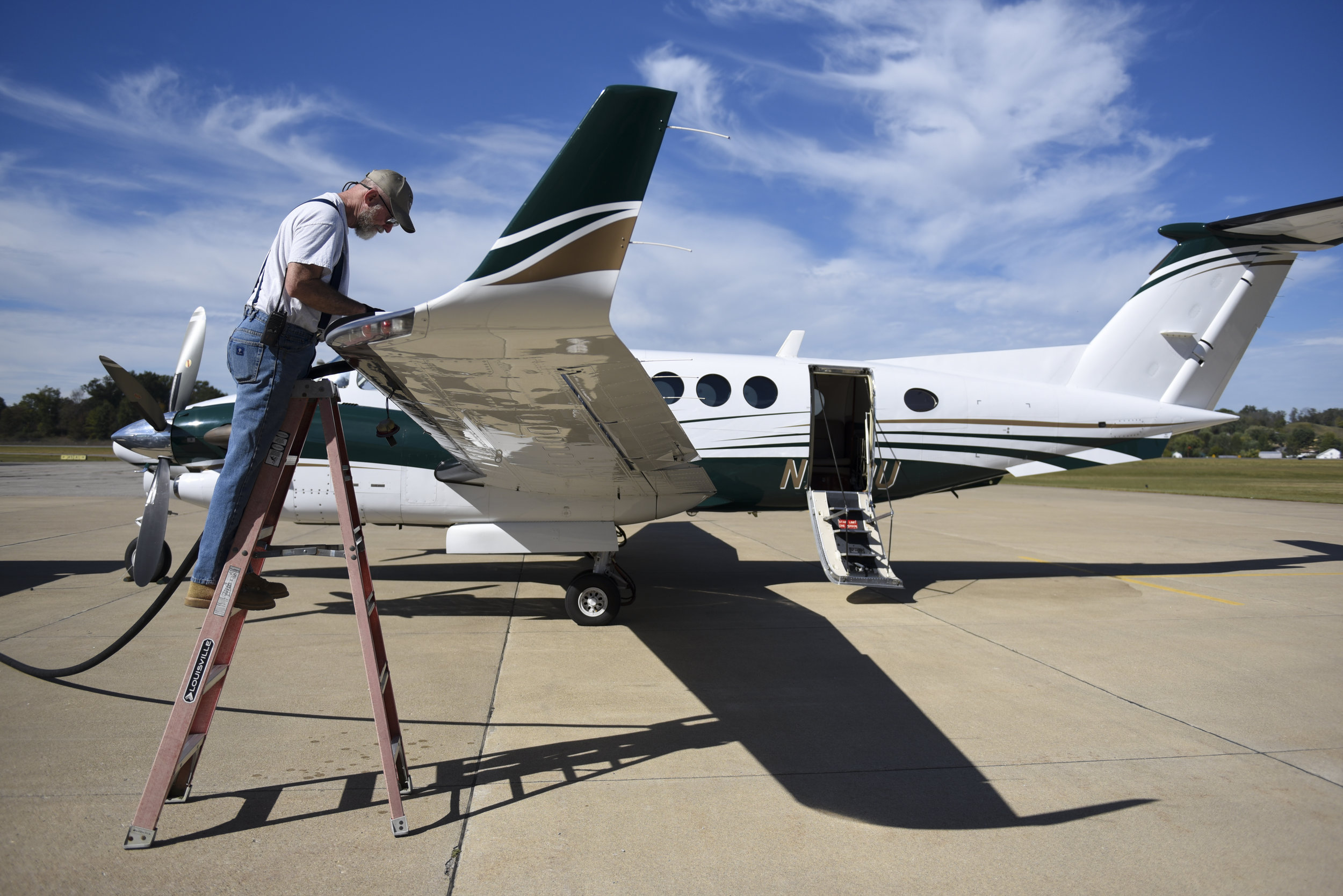 Bob Black fills the tank of the Ohio University King Air with fuel in preparation for university's trip to deliver donations to victims of hurricanes in Puerto Rico.