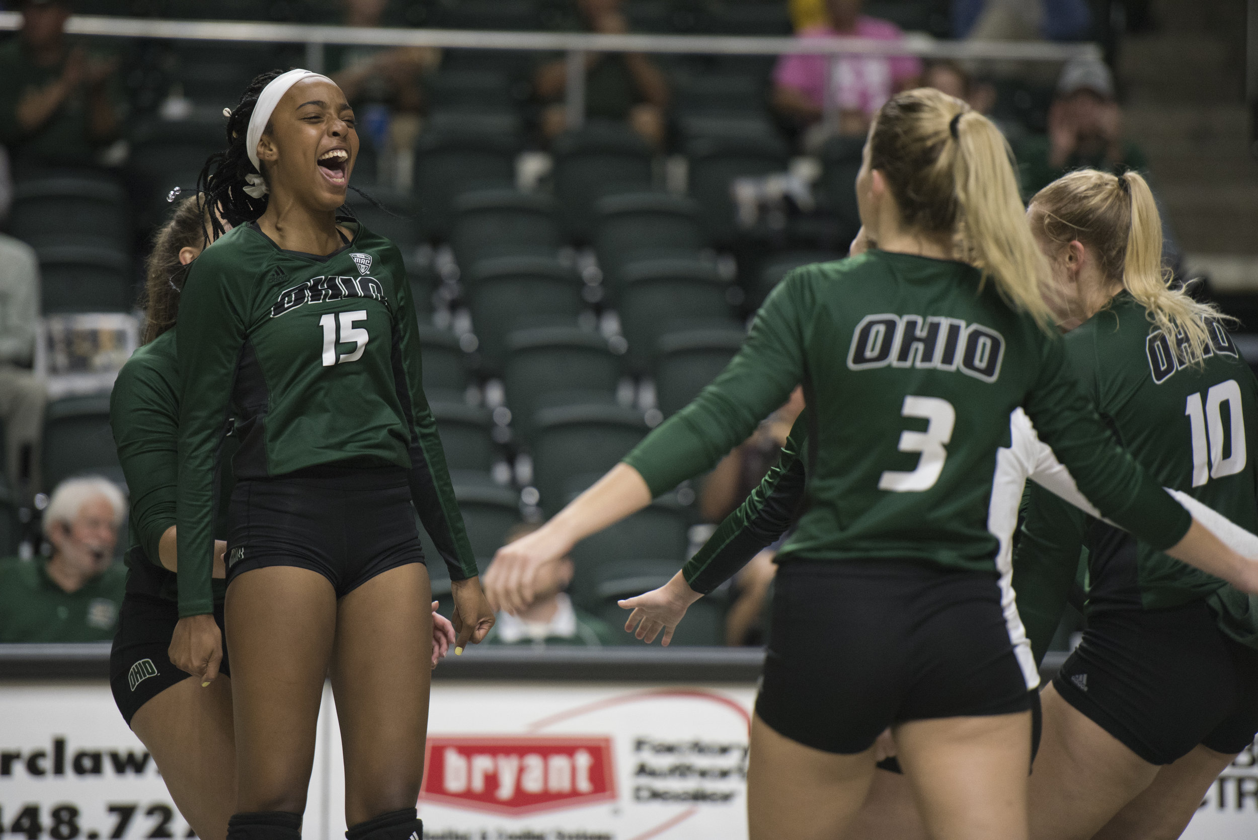 Tia Jimerson (#15) cheers as she runs to embrace her teammates Lizzie Stephens (#3) and Carley Remmers (#10) after scoring a point against Georgia on Sept. 1, 2017 at the Convo.