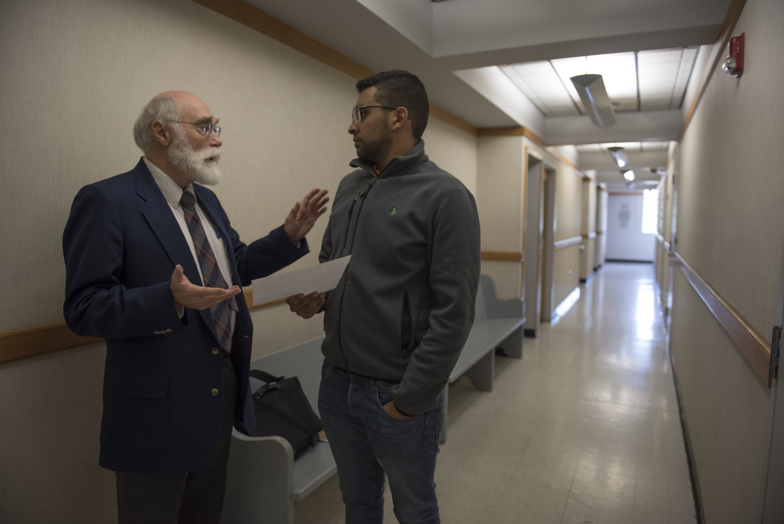 Pat McGee and his client Karim Elmasry, an Ohio University student from Egypt, discuss Elmasry's case outside the courtroom after finishing legal proceedings on Sept. 6, 2017 at the Athens Municipal Court in Athens, Ohio.