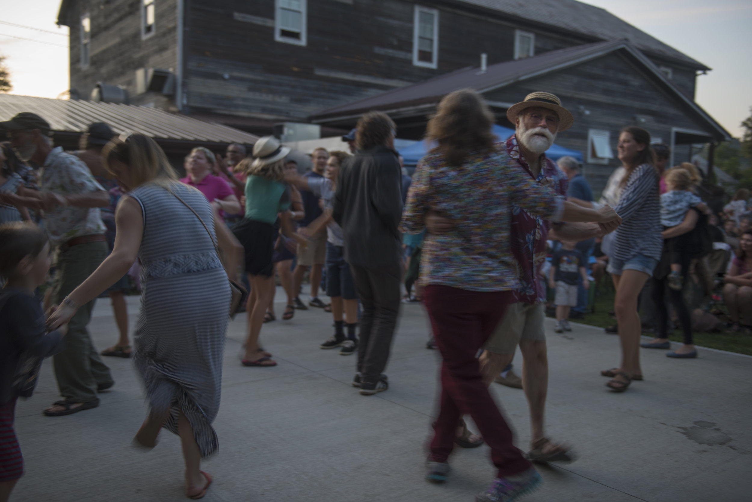 McGee and his wife Robin dance together to the music of The Wild Honeybees at Eclipse Country Store in The Plains, Ohio on Sept. 3, 2017. McGee loves to dance and occasionally attends contra dance classes at Arts West with other city councilmembers.