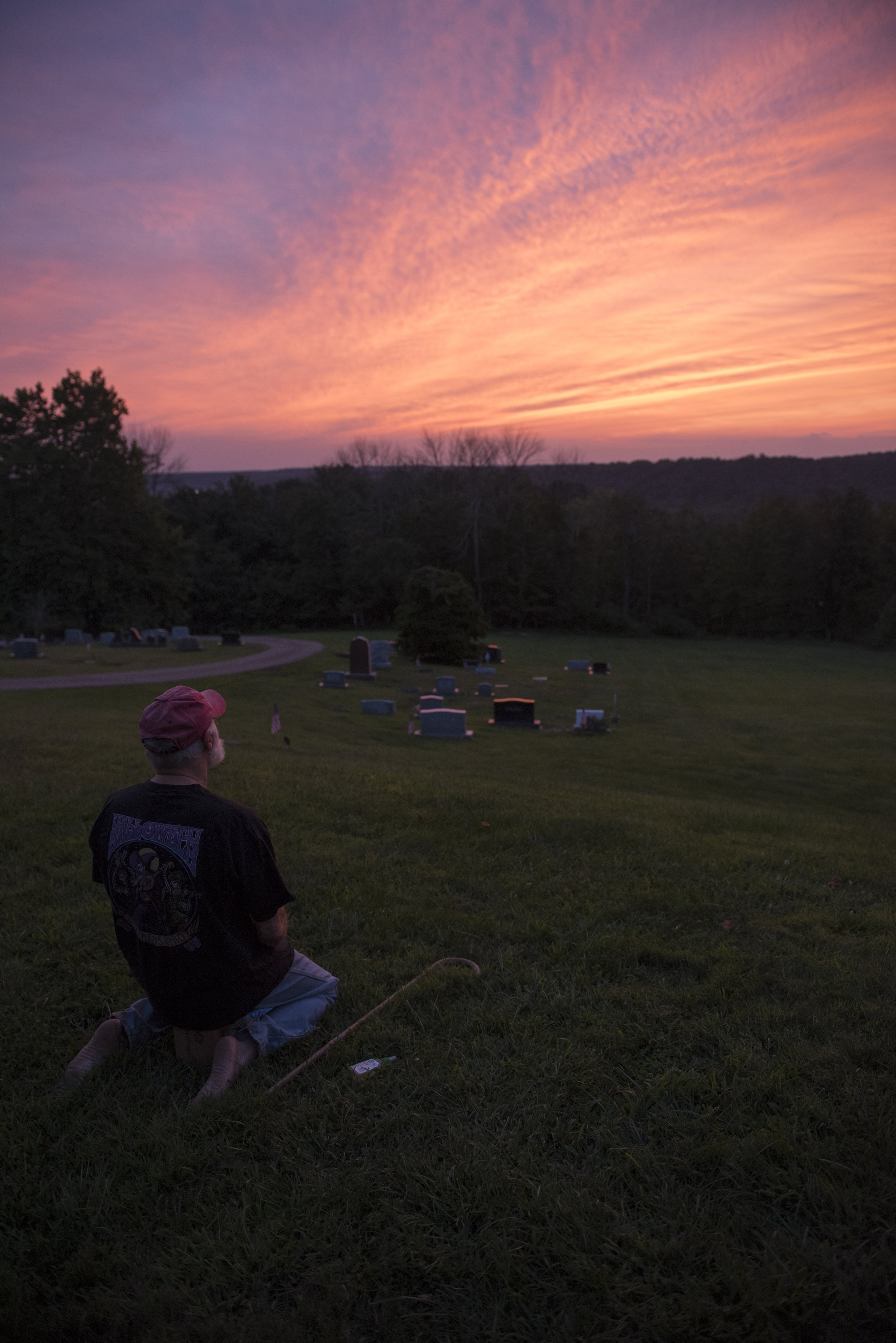 Patrick McGee enjoys the sunset in a cemetery in Athens, Ohio on Aug. 30, 2017. McGee sits in a Japanese meditate pose and takes the time to think and reflect.