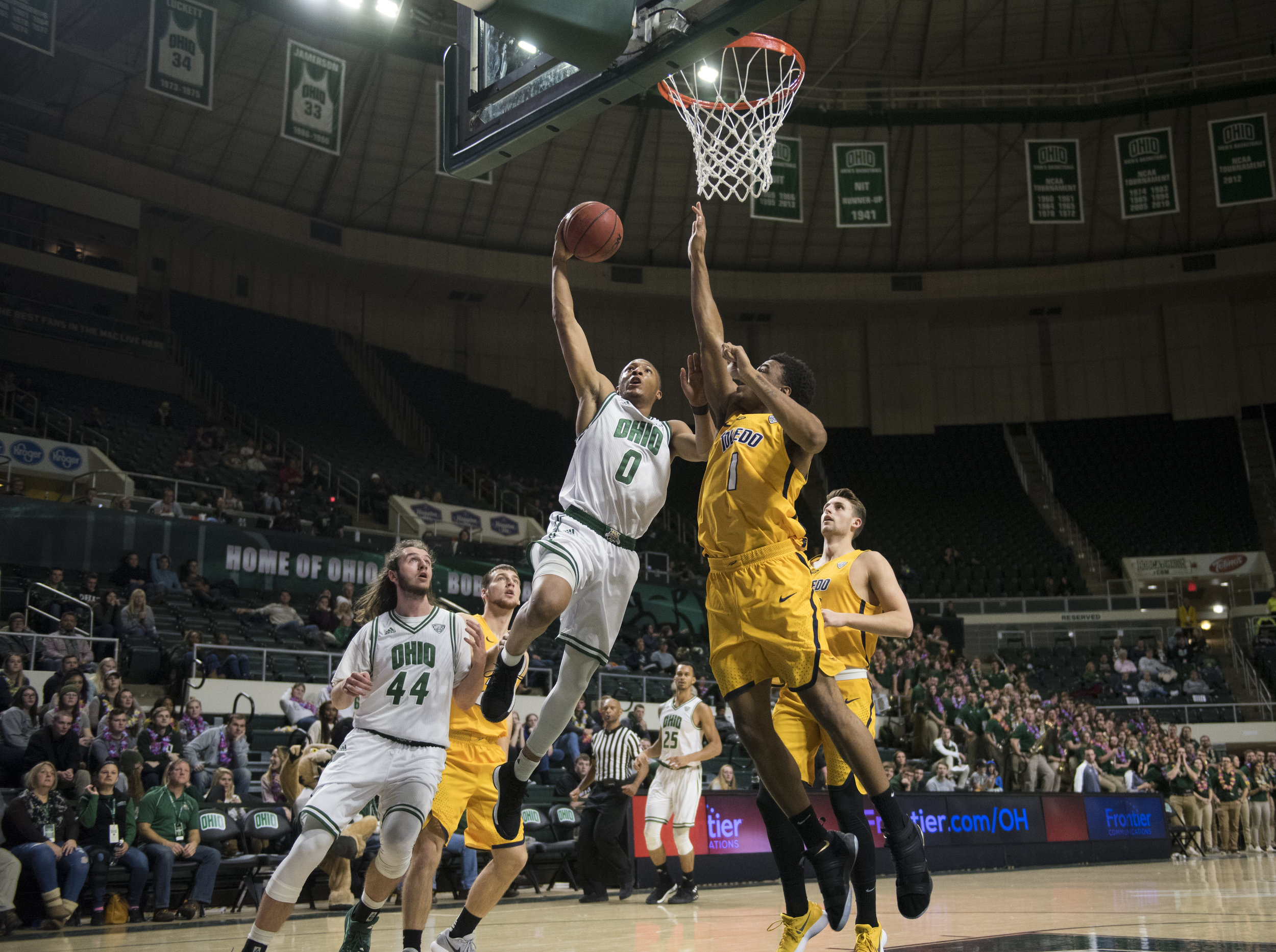 Ohio University's Zach Butler gets blocked by Toledo as he drives to the basket on Jan. 16, 2018.
