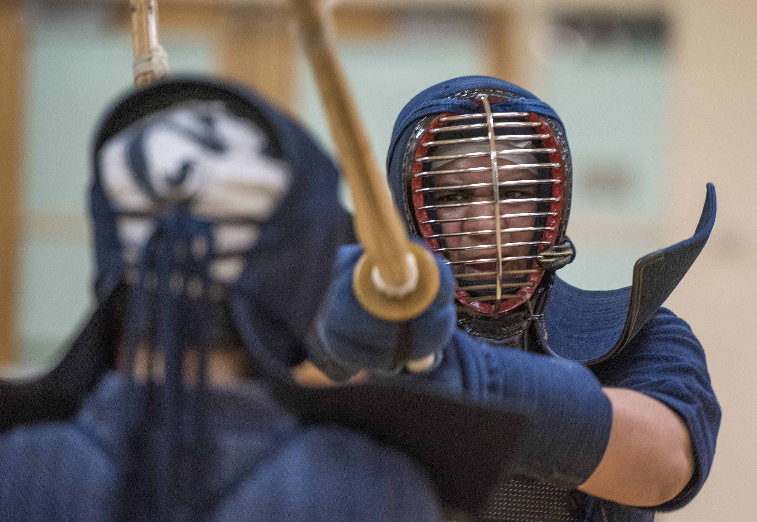 Alex Airado, a senior studying criminology, practices kendo moves against another member of the Ohio University kendo club.