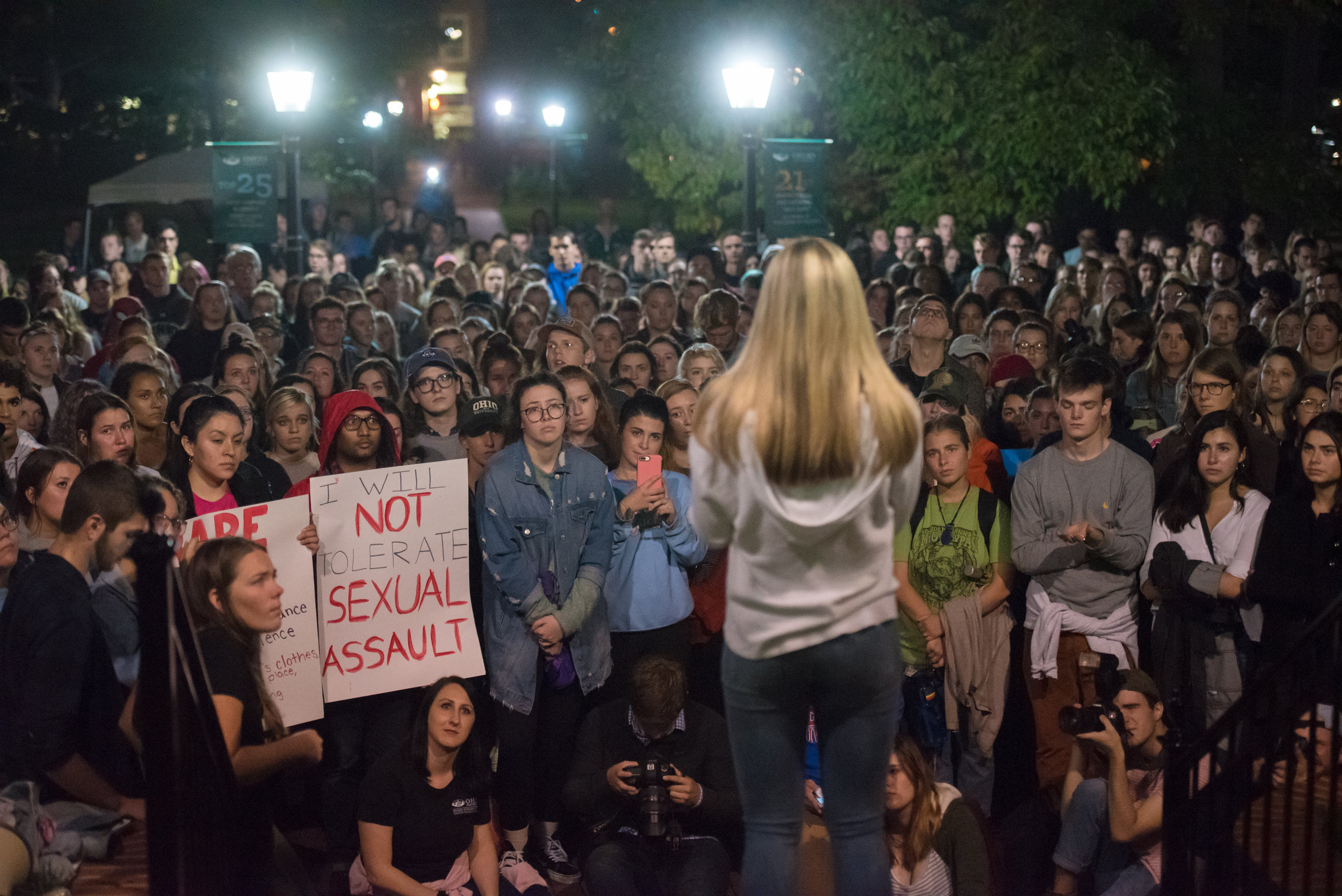 Protesters listen to Tori Doran tell the story of her rape during the It's On Us Bobcats protest on Sept. 27, 2018 outside of Cutler Hall in Athens, Ohio.
