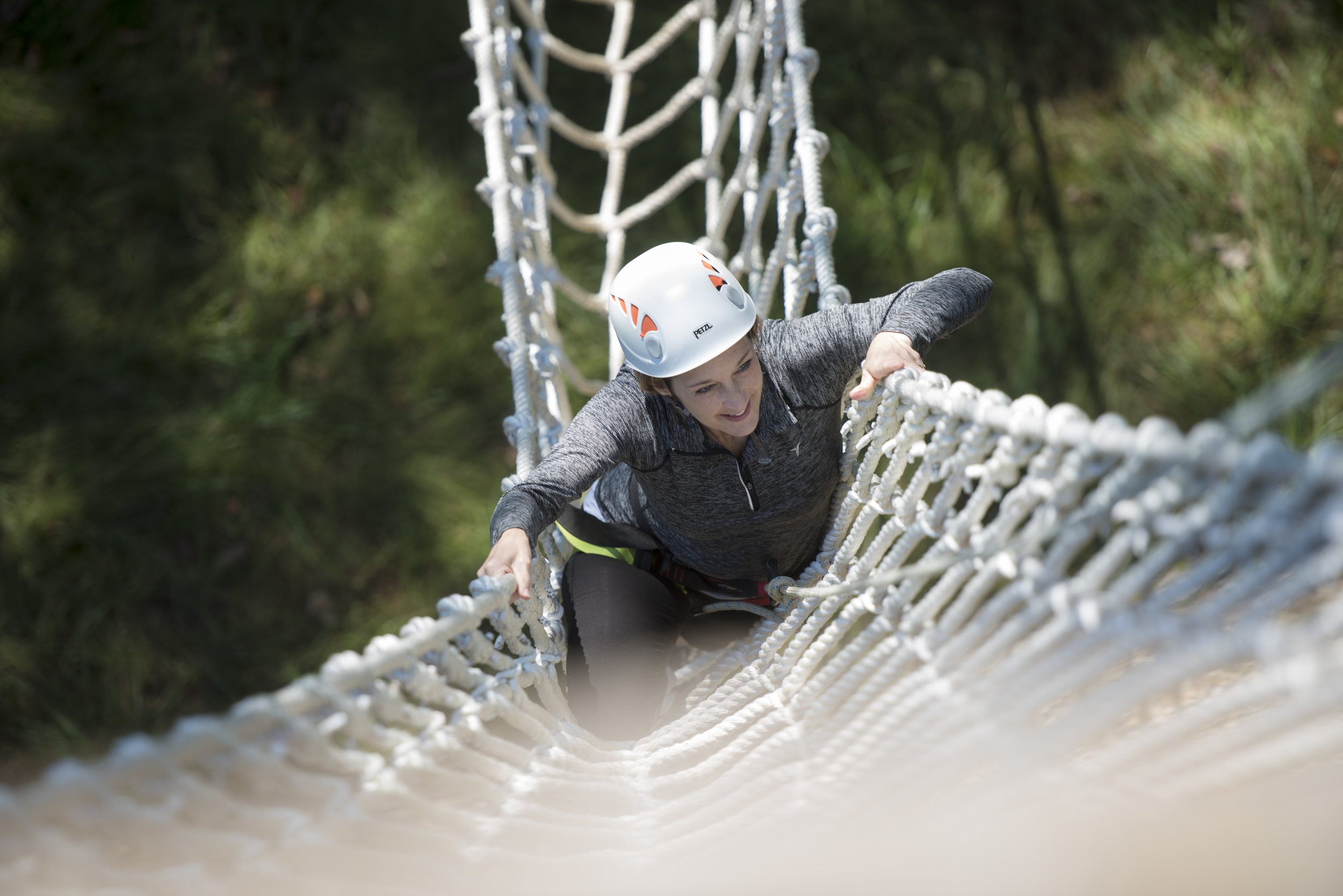 Pamela Gaboury climbs up the ziplining tower at the Challenge Course on Oct. 2, 2018 at The Ridges in Athens, Ohio.