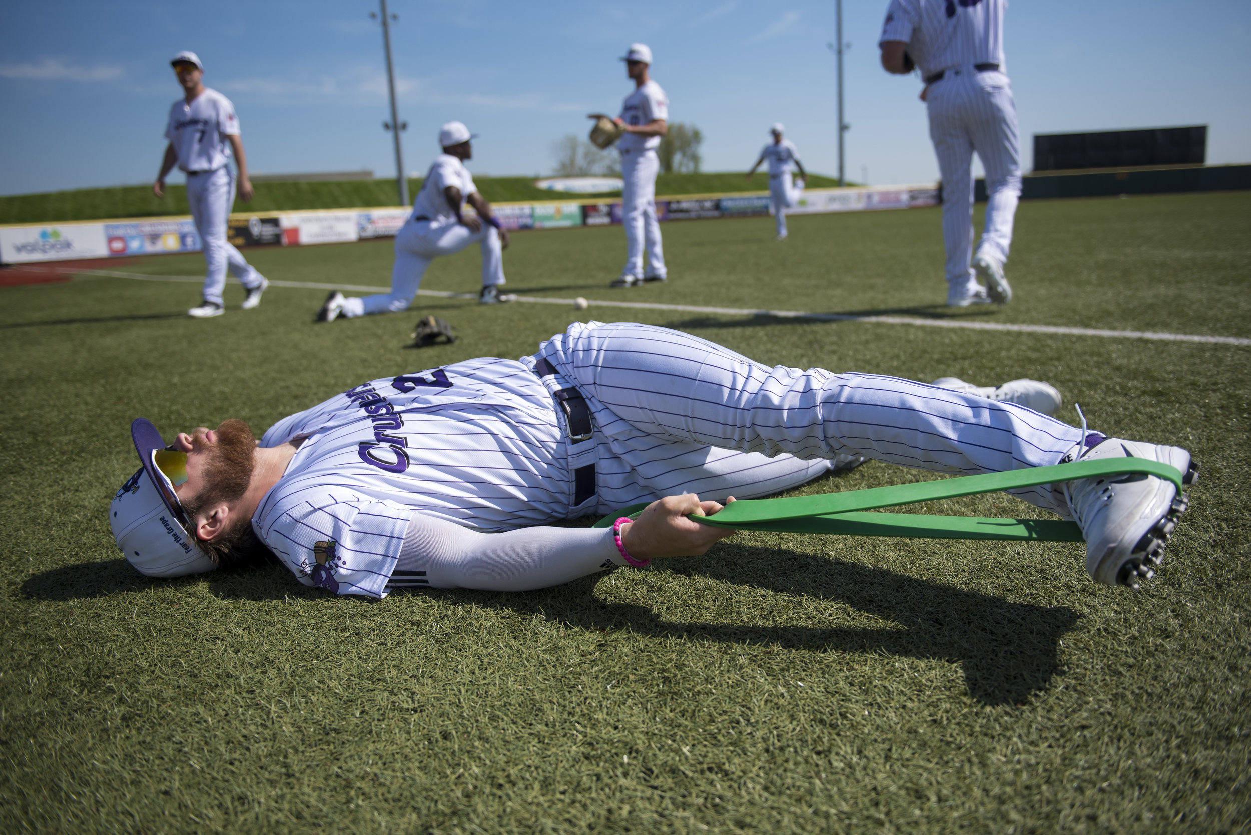 Lake Erie Crushers' Doug Trimble warms up before facing off with the Normal Cornhuskers on May 17, 2018 at Sprenger Stadium in Avon, Ohio.