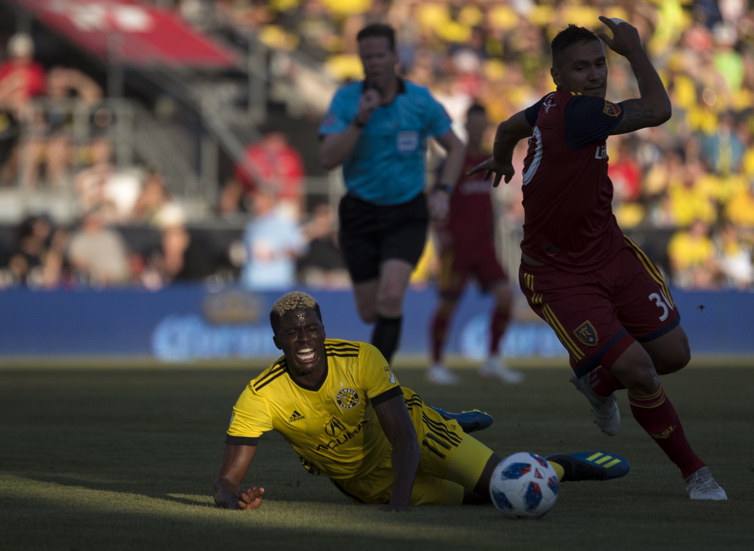 Columbus Crew forward Gyasi Zardes (left) is tripped by Real Salt Lake's Marcelo Silva (right) during the game against Salt Lake City on June 30, 2018.