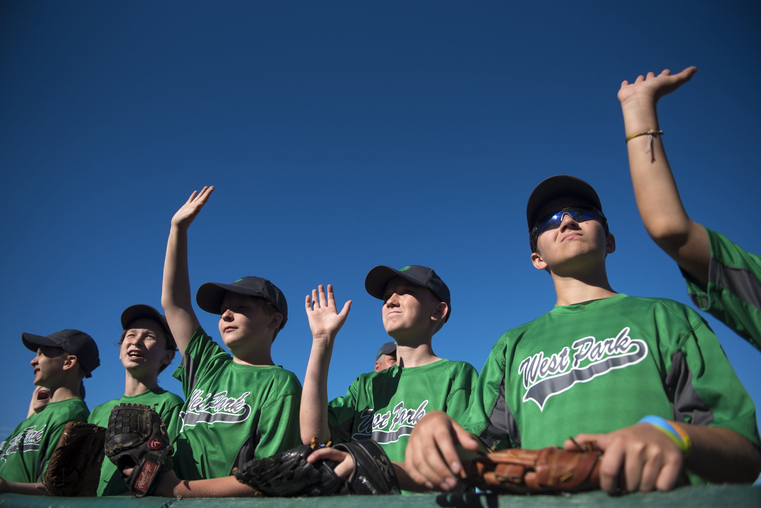 Little league players wave to fans prior to escorting members of the Lake Erie Crushers onto the field on July 7, 2018 at Sprenger Stadium in Avon, Ohio.