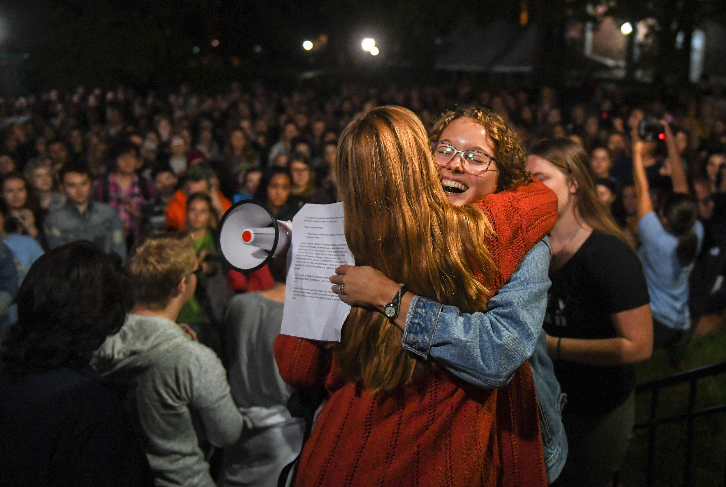 Mallory Golski embraces another protestor during the It's On Us Bobcats rally against sexual abuse on Sept. 27, 2018 outside Cutler Hall. The protests followed an increase of sexual assaults at Ohio University.