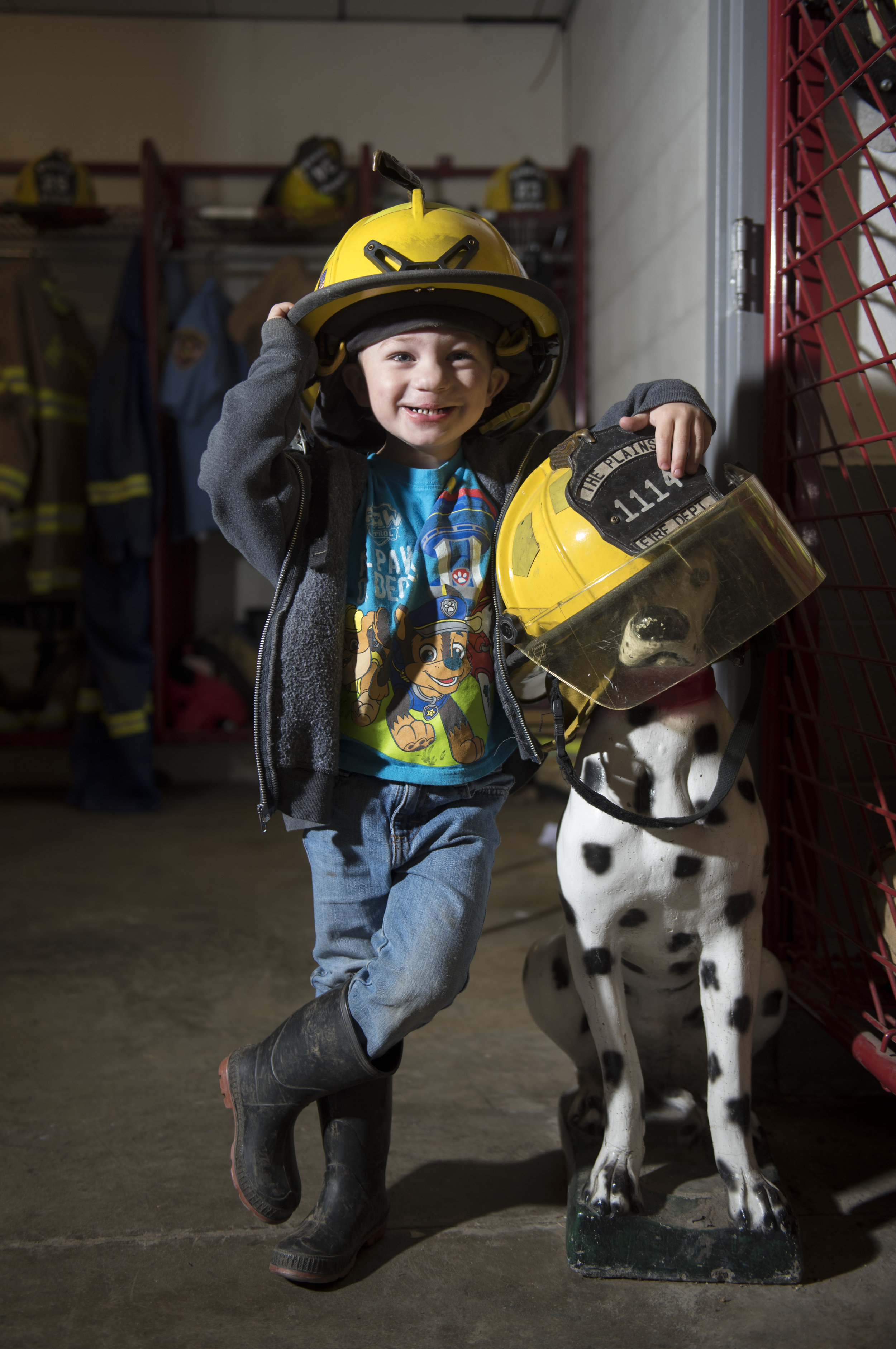 Mason Cottrill poses for his portrait inside The Plains Volunteer Fire Department on Nov. 13, 2018 in The Plains, Ohio. Cottrill's father is one of the firefighters.
