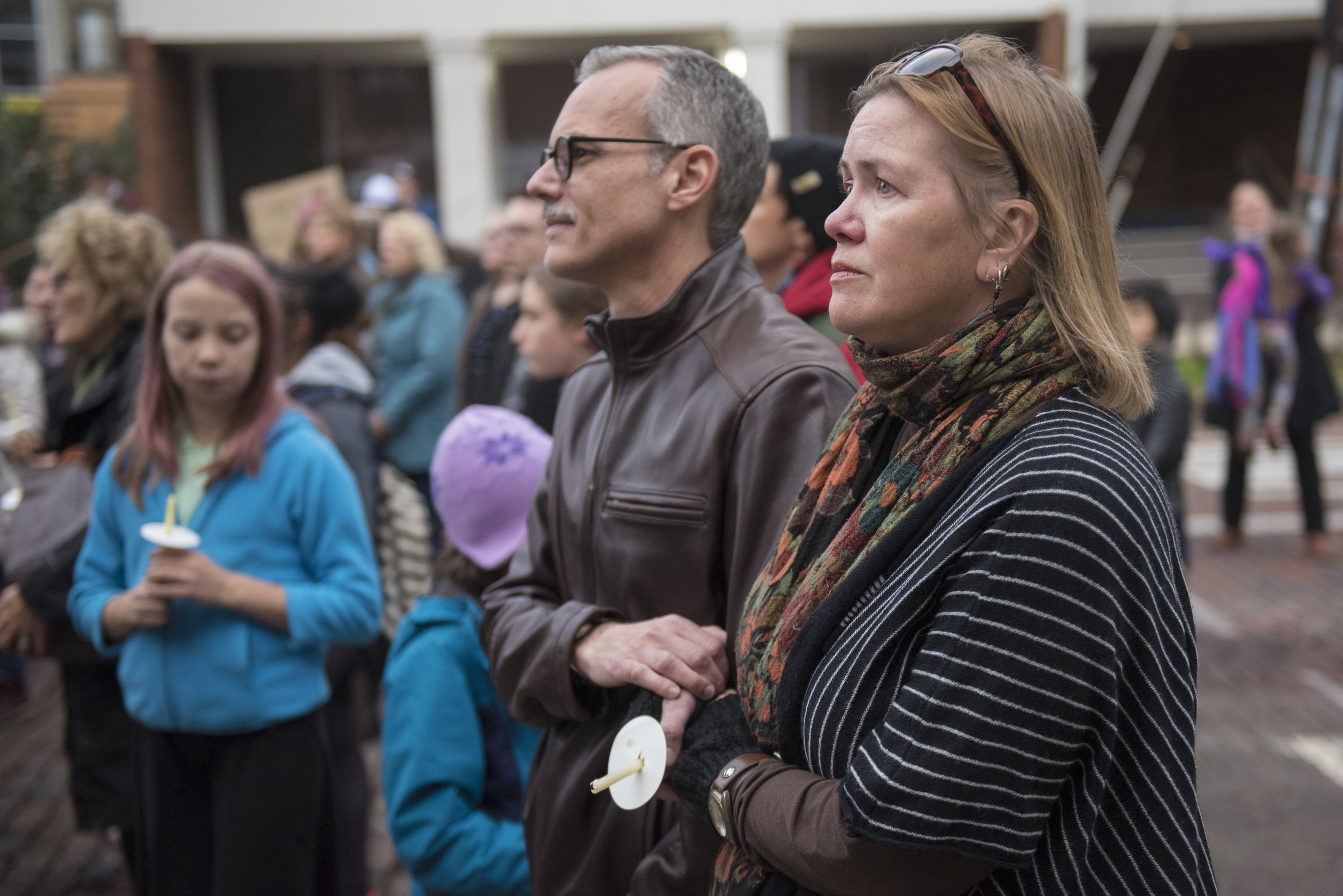 Stephen Dierna and Melissa Wales listen to speakers during a candlelight vigil held by Hillel on Oct. 29, 2018 for the victims of a mass shooting at a synagogue in Pittsburgh.