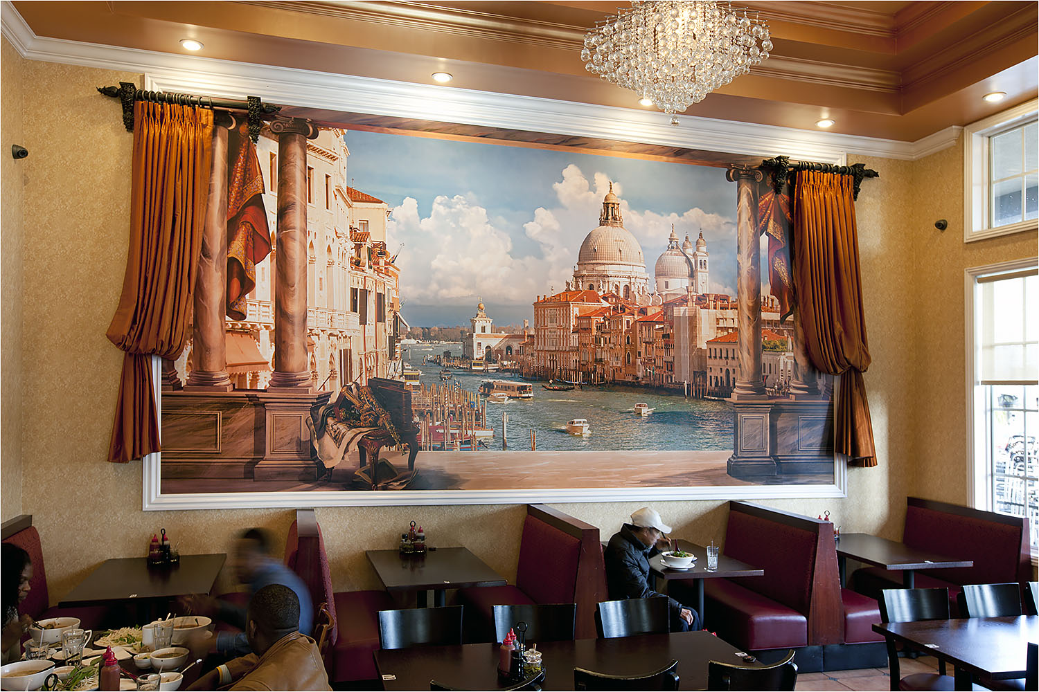 Printed mural made on a durable and washable commercial grade wall-covering medium.  This mural is a combination of photo, hand-painted and digital art. A good example of a photo mural in a restaurant.