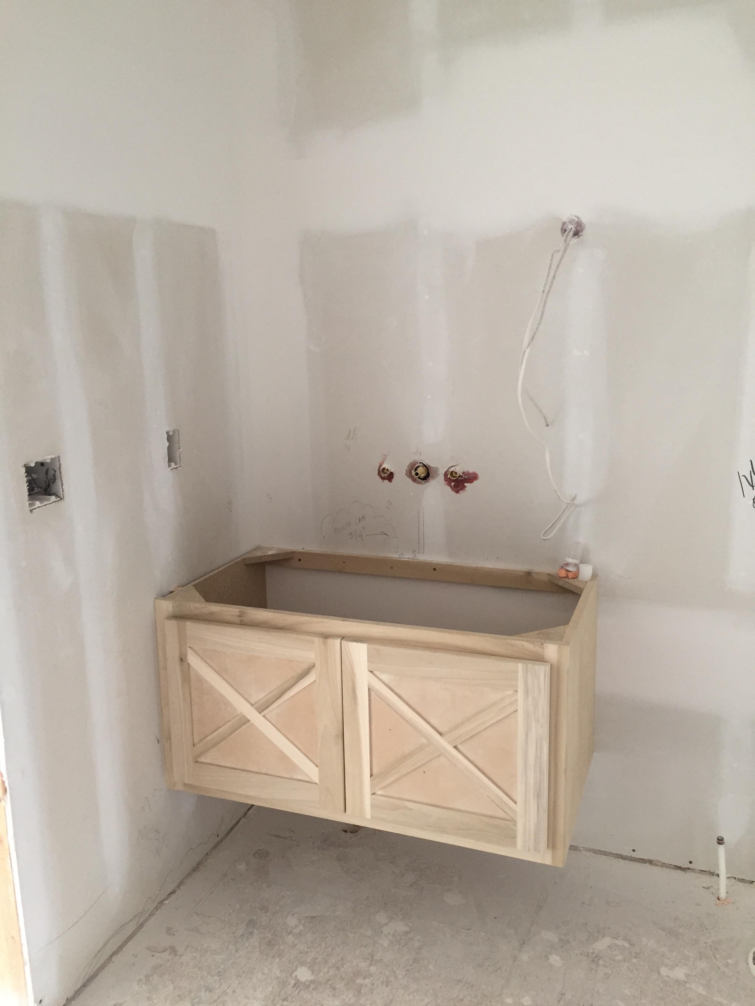 Floating vanity in guest bedroom 1