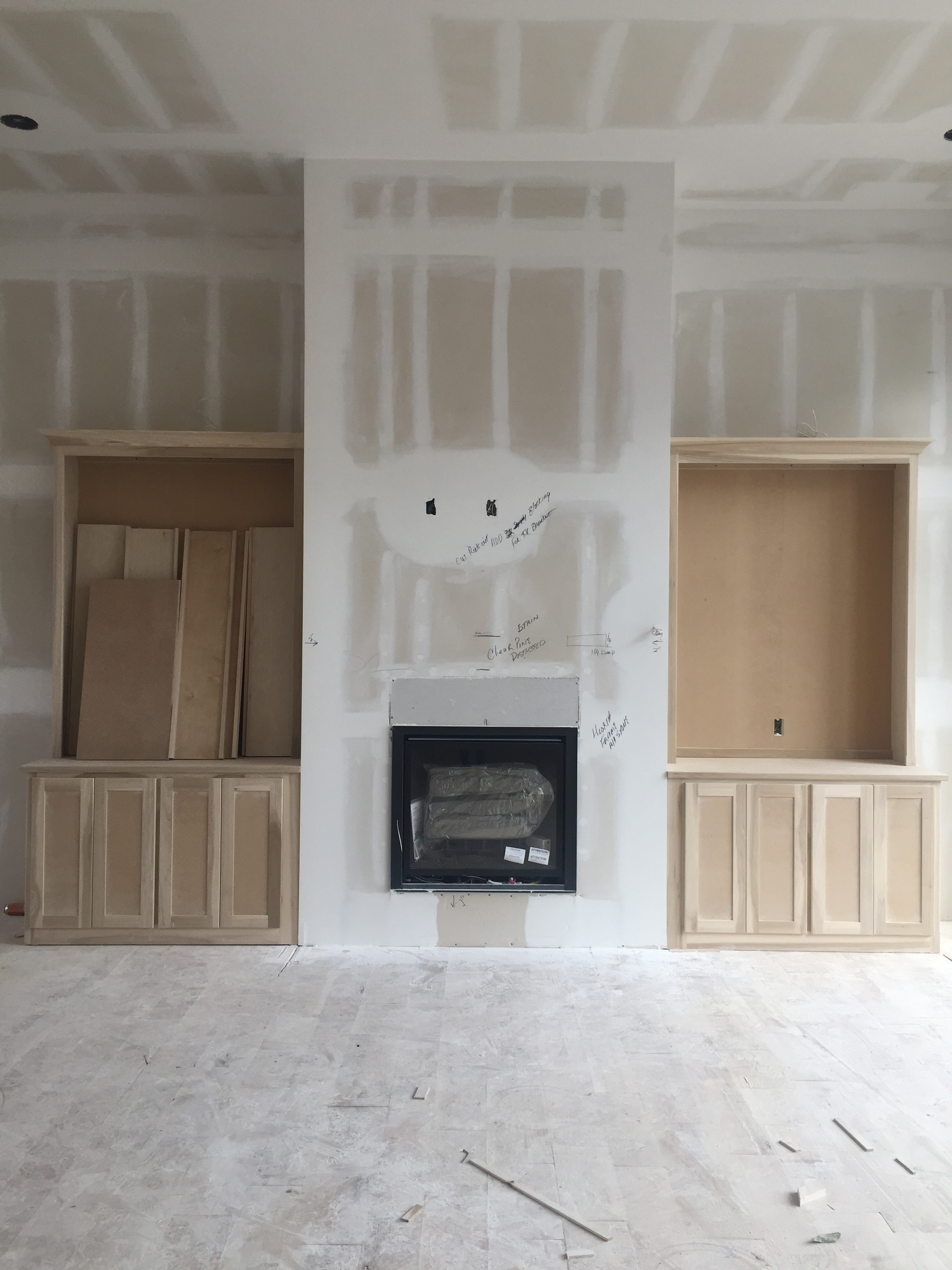 Picture floor to ceiling grey stone! The built ins on either side will be white