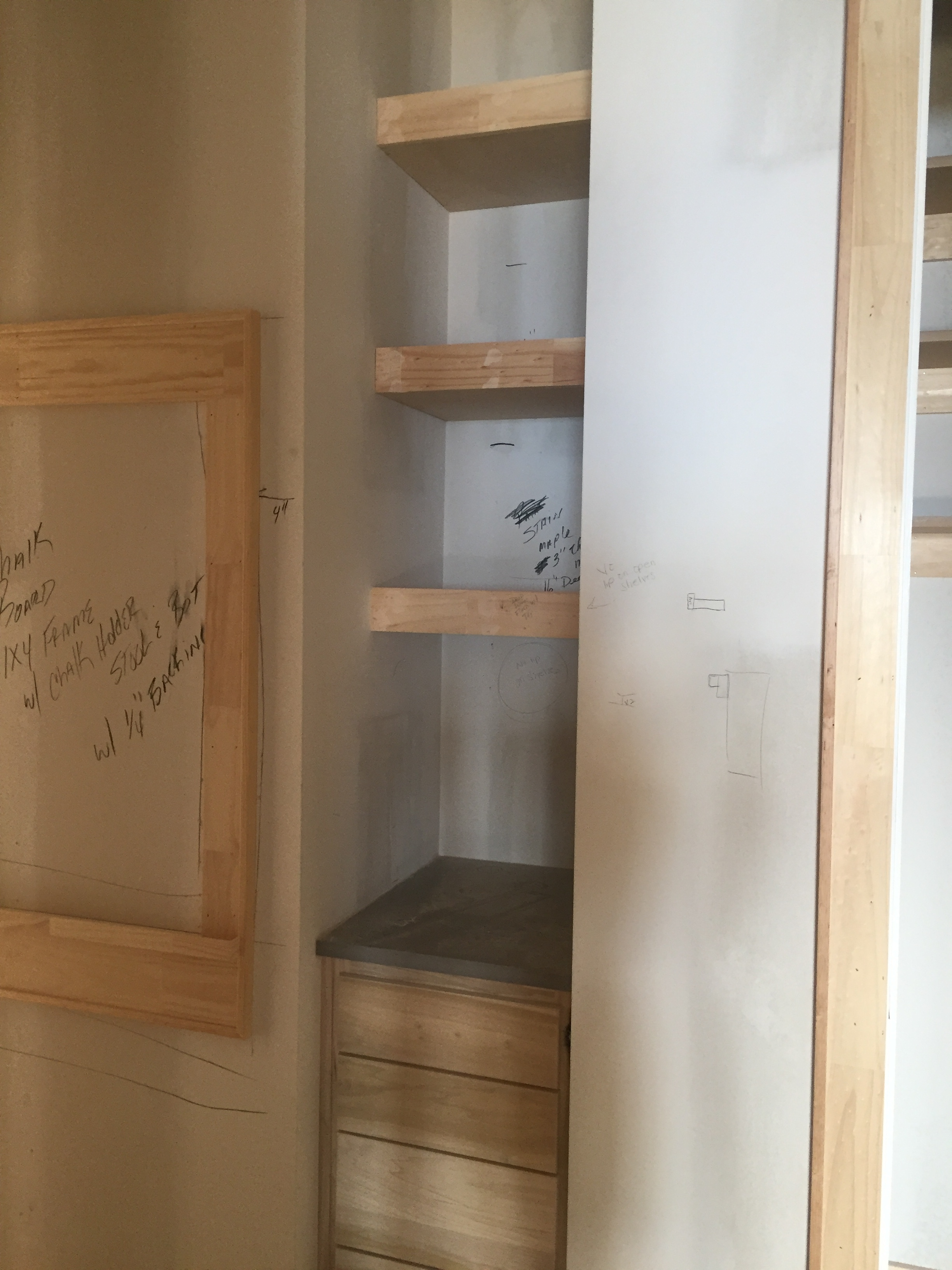 And there are the open shelves and the chalk board. They even built a little chalk tray, our trim guys attention to detail is amazing!