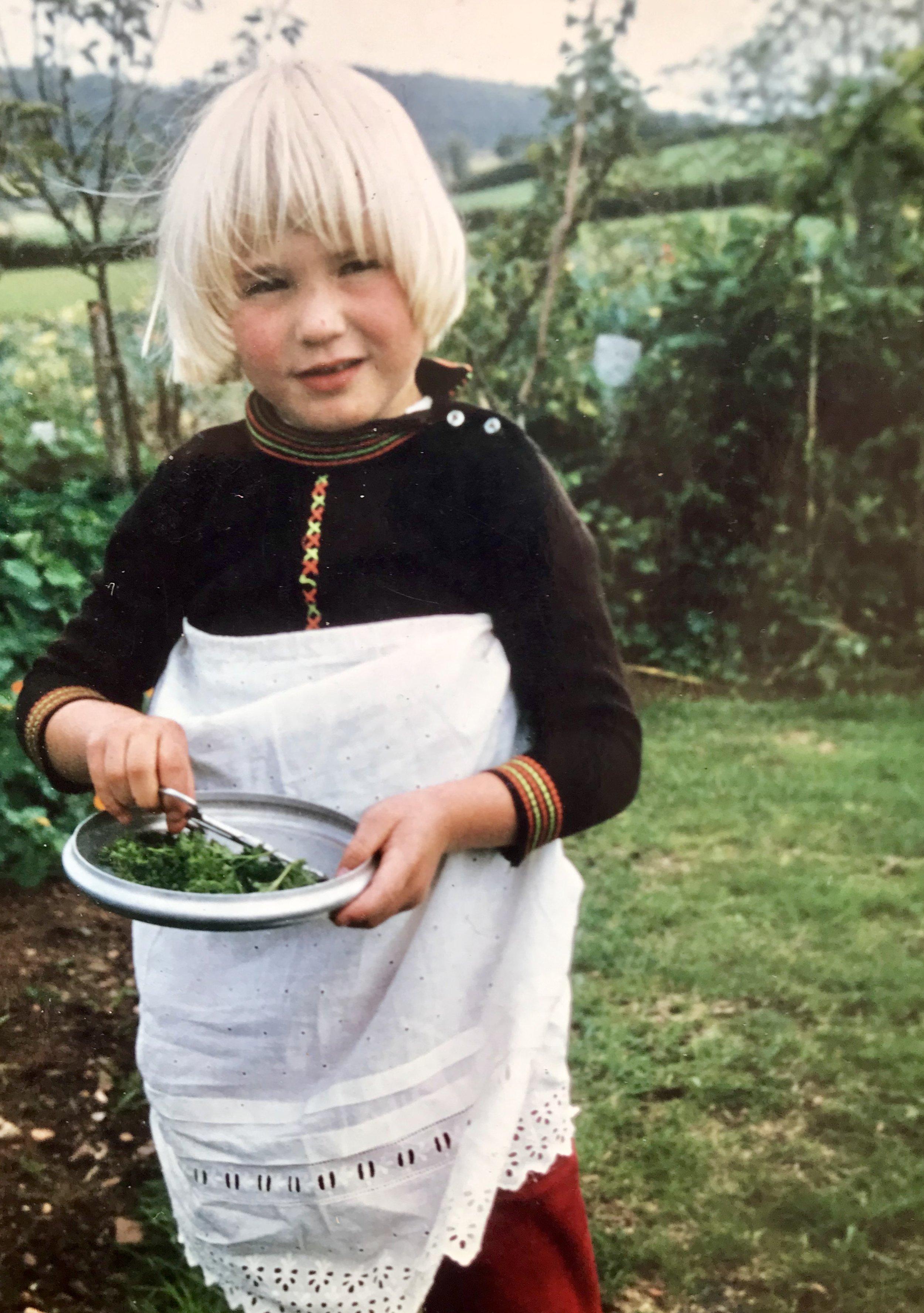 Me at four making something herbal!  Photo by my Mum!