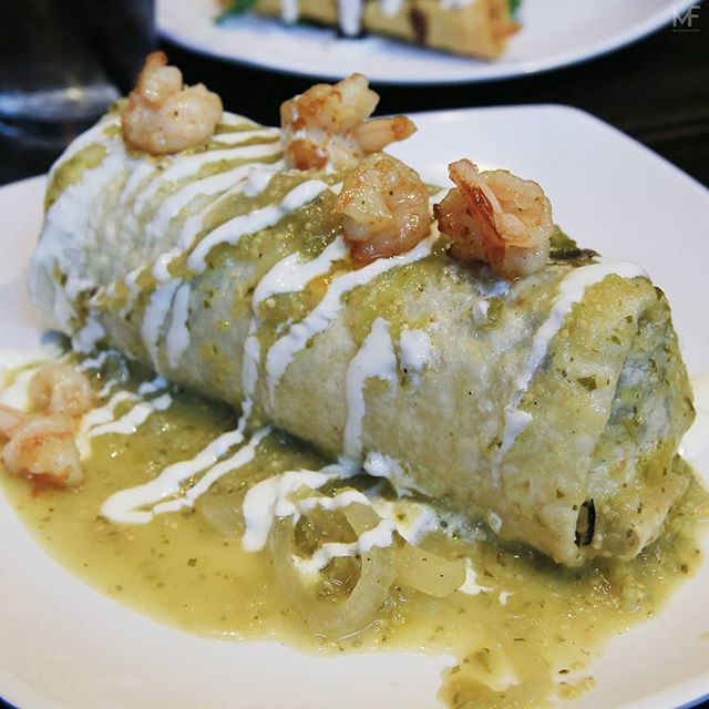 Wednesdays are a drag. Who agrees? Pictured here is the Surf n Turf burrito from @bartaconyc. $20. Pricey yet loaded with protein. It's the size of your head too.