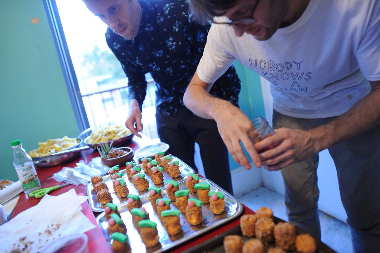 """At the beginning of """"WhoDonut: A Cereal Killing,"""" after navigating a room filled with dozens of half-eaten cereal bowls, participants look out the window to discover the only person who had information to the murder has themselves been murdered, and rests inside a chalk outline of milk powder. The first course, shown being prepared, is cereal-crusted milk-battered walleye mouse with lemongrass marshmallow."""