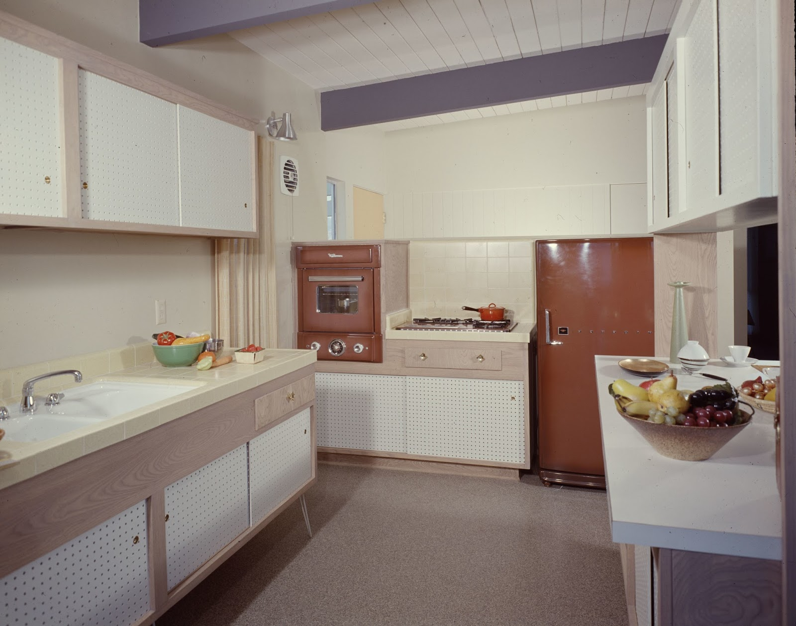 An original kitchen with pegboard cabinets held up by hairpin legs