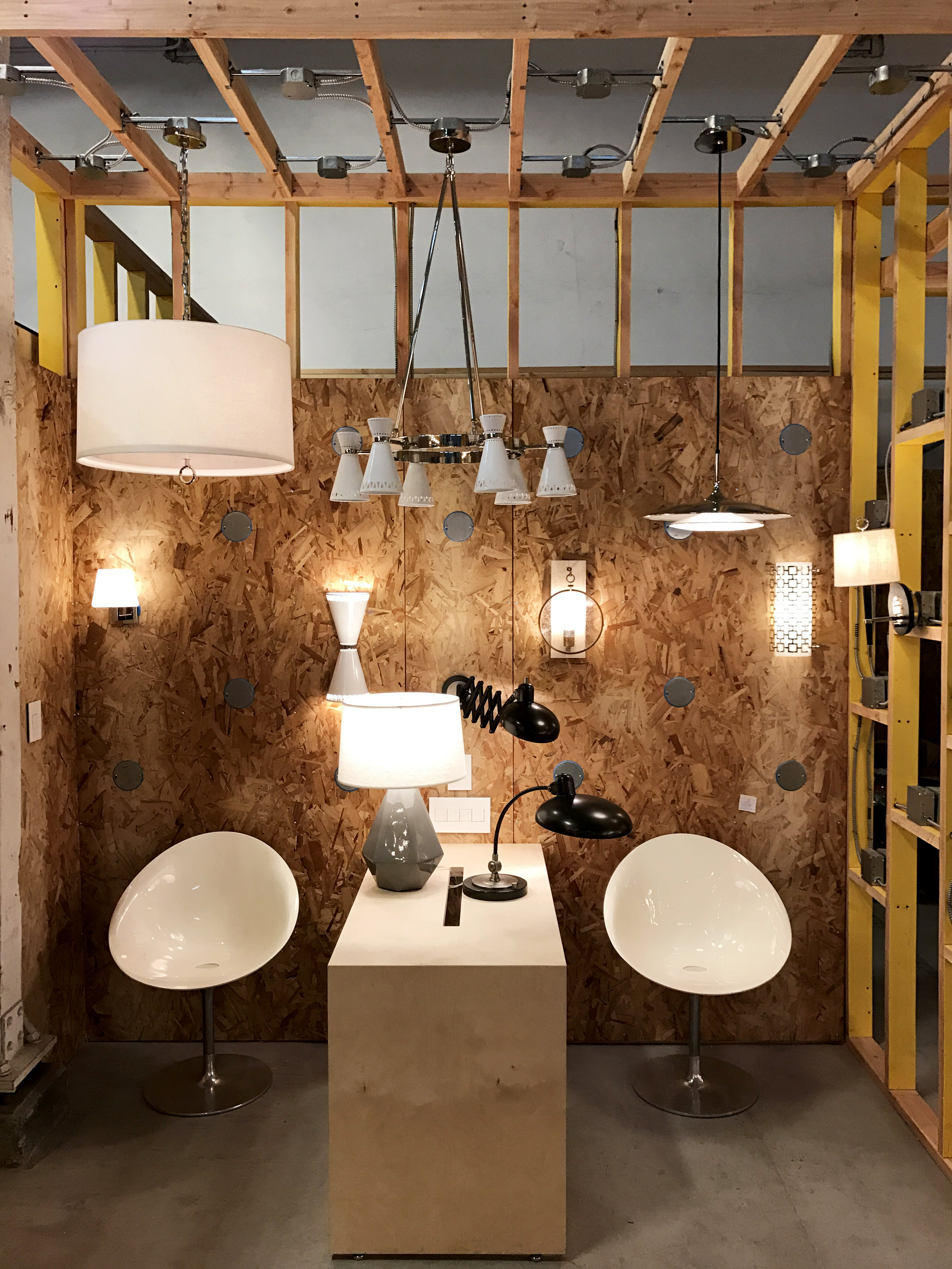 These fixtures are from Robert Abbey and feature designs by  Jonathan Adler and Rico Espinet. The chairs are by Philippe Starck for Kartell.