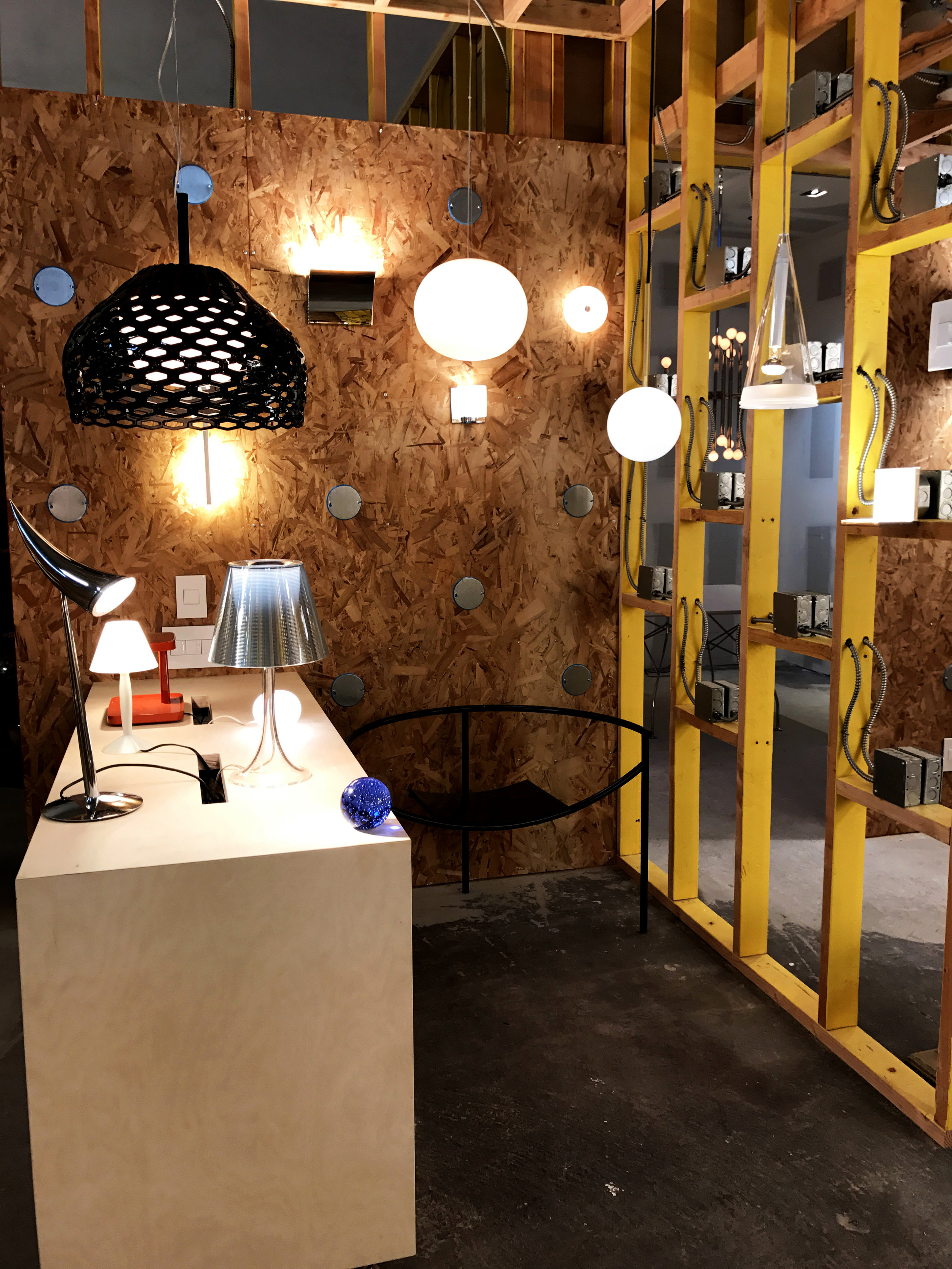 This display features fixtures by Flos from Italy and a vintage Dr. Sonderbar Chair by Philippe Starck (Our Price $1,750 compared to 1stDibs.com $3,211). One of the sconces and three of the table lamps are also designed by Philippe Starck.