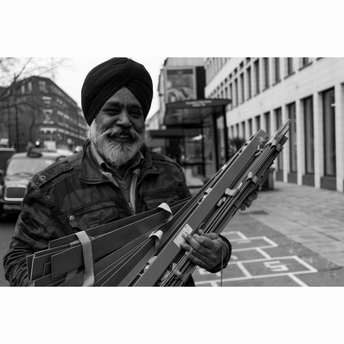 Man carrying wood, London - January 2017