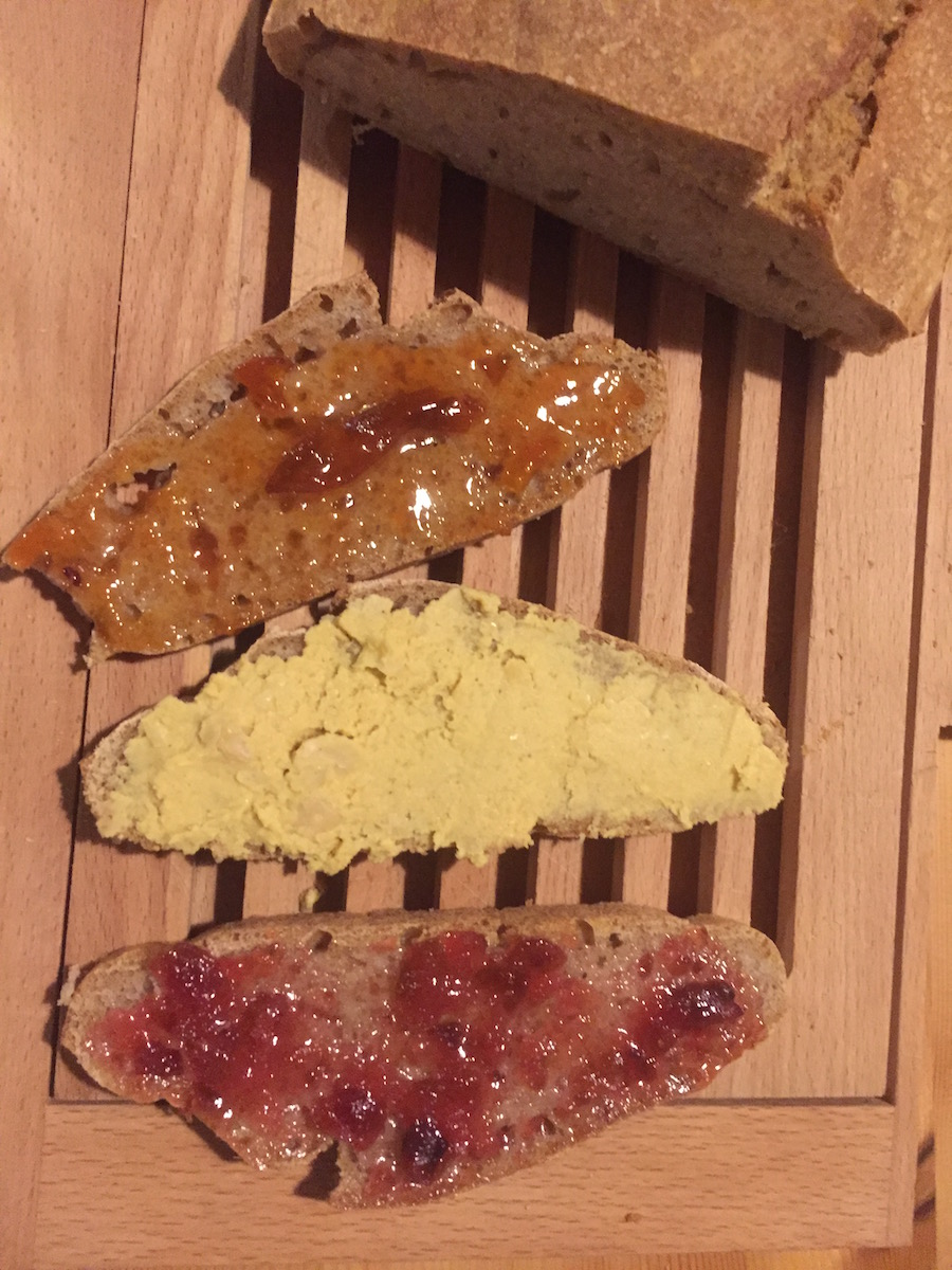 Warm bread with home made hummus,  Little Herd 's wild plum jam and my mother-in-law's fig & lemon jam...