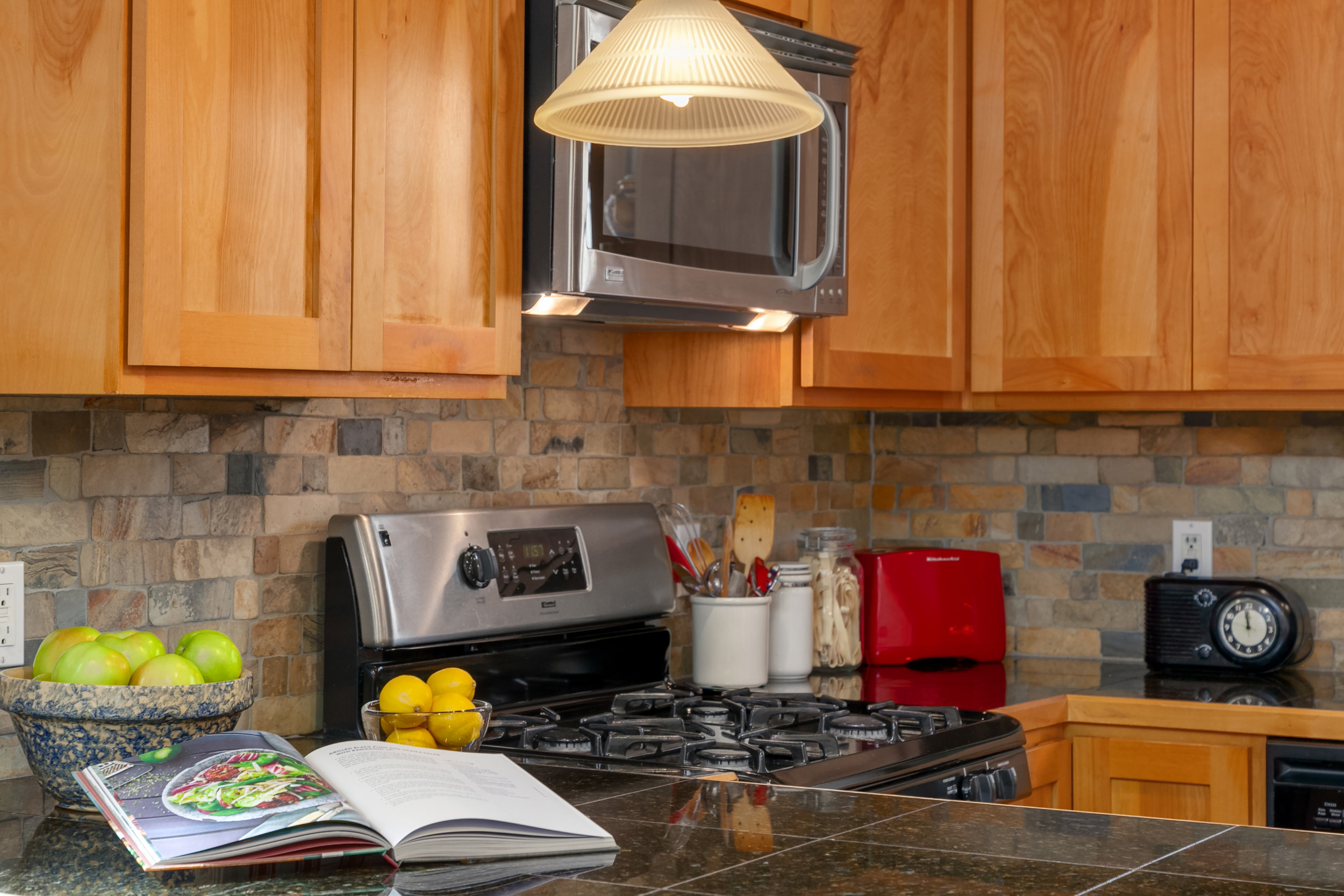 Granite counters, slate backsplash, hardwood cabinetry.