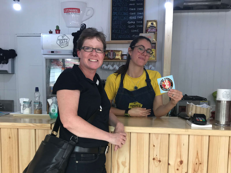 Our friend Mary during a visit to Santiago popped in at Happy Days Waffles and Coffee and made instant friends! The shop owner shown here proudly displaying her new NWA sticker!