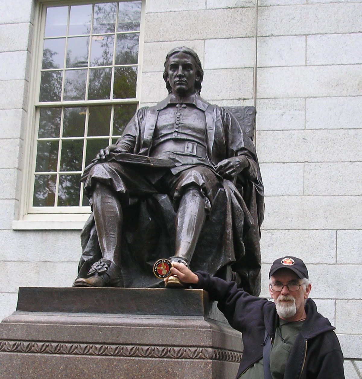 T with John Harvard, English minister, and colonist. In Cambridge, Massachusetts.