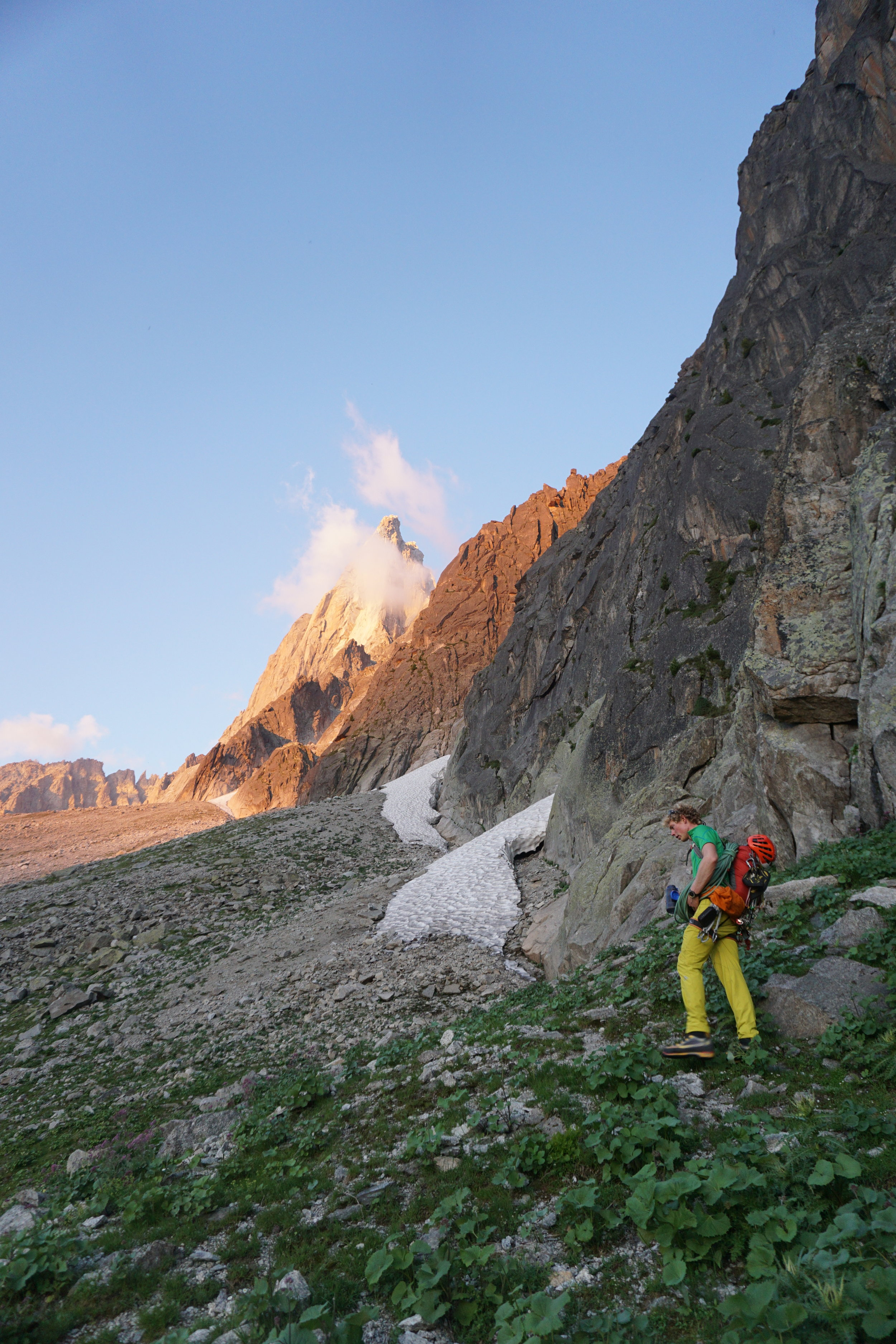 Approaching Le Dru in beautiful evening light. The downside of taking a tiny rucksack is everything hangs off it during the approach! Photo: Uisdean Hawthorn