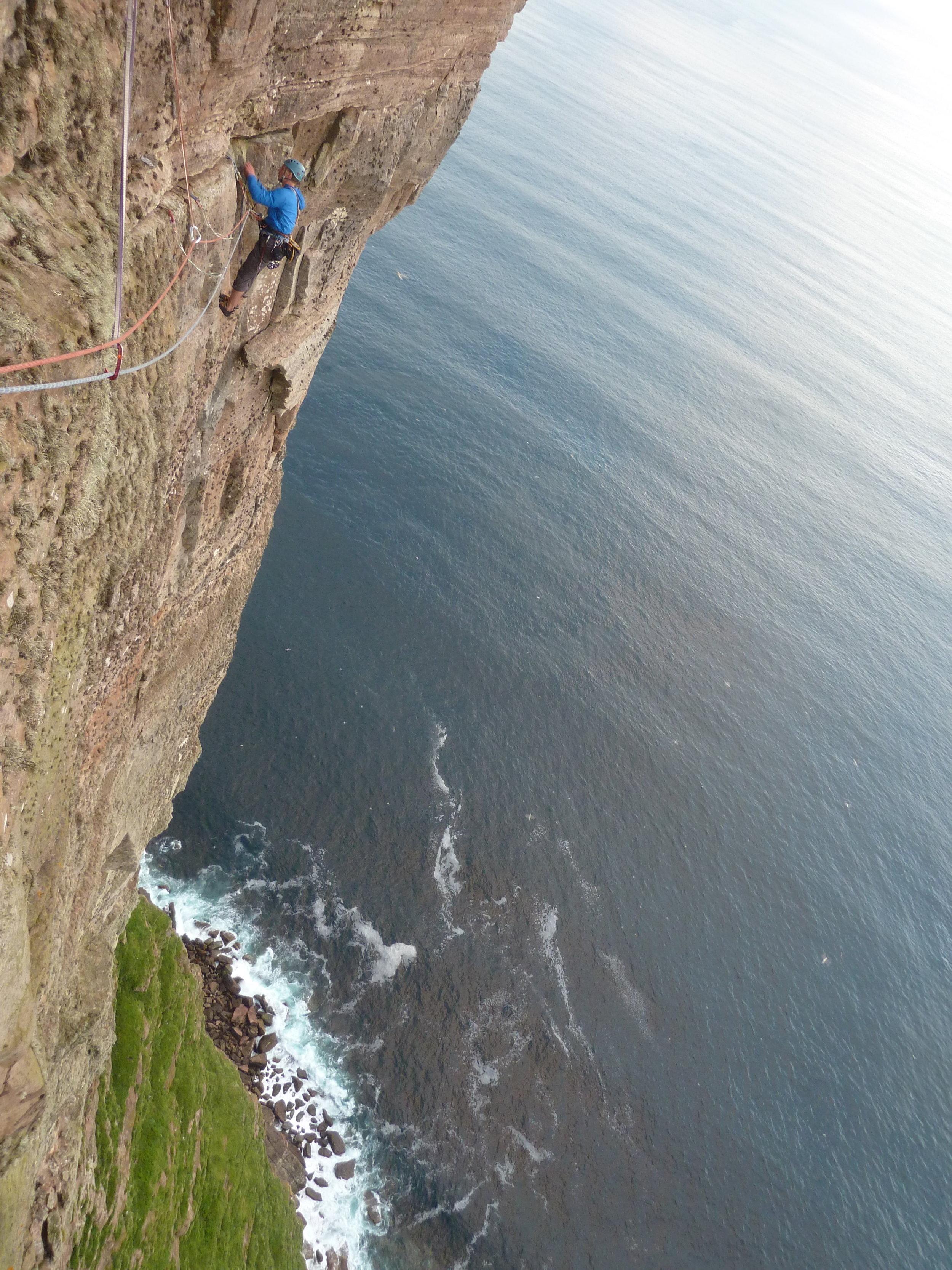 Tony half way up The Long Hope Route (E7 v. fulmar).