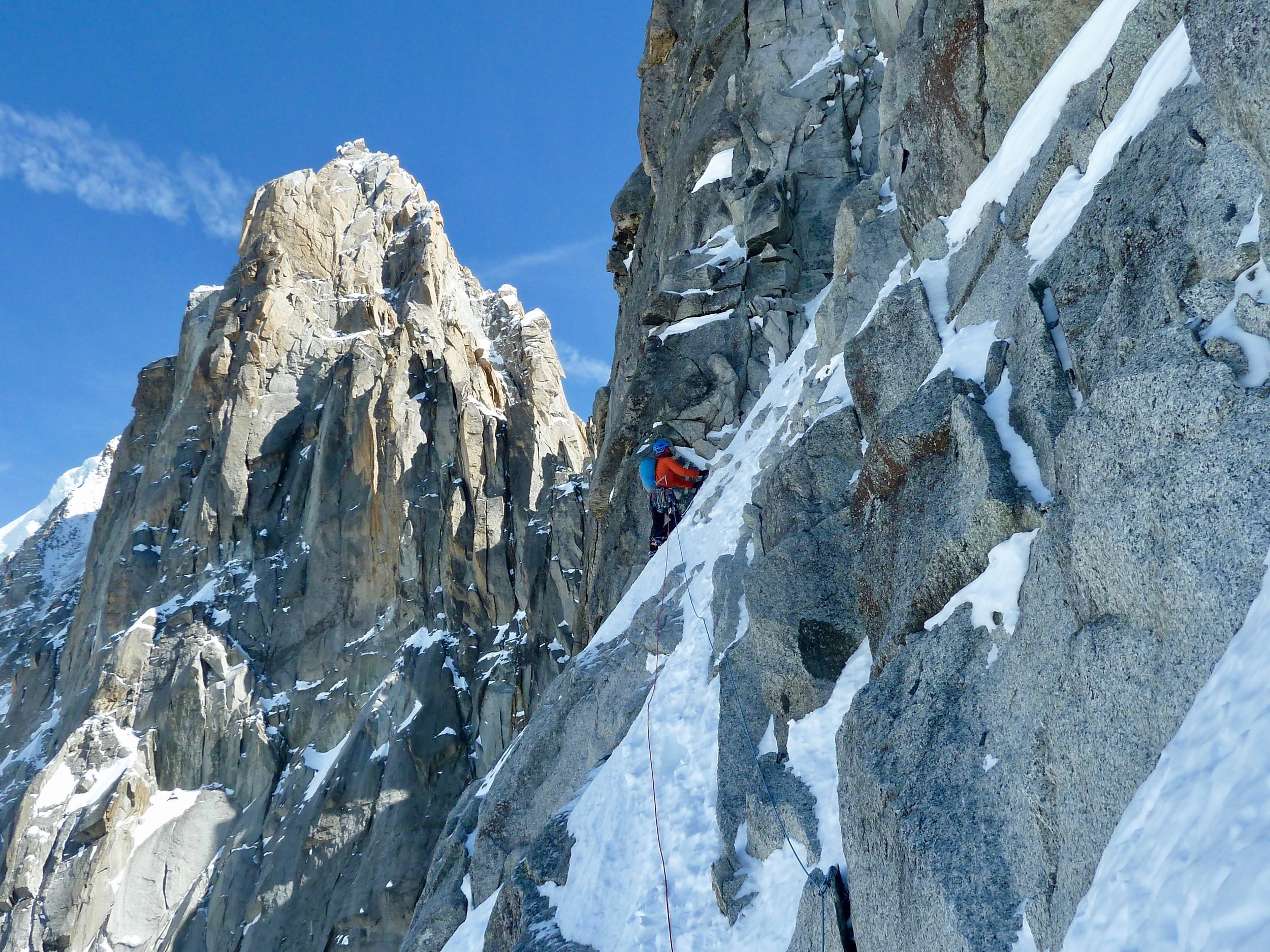 kim traversing leftwards on the first snowpatch