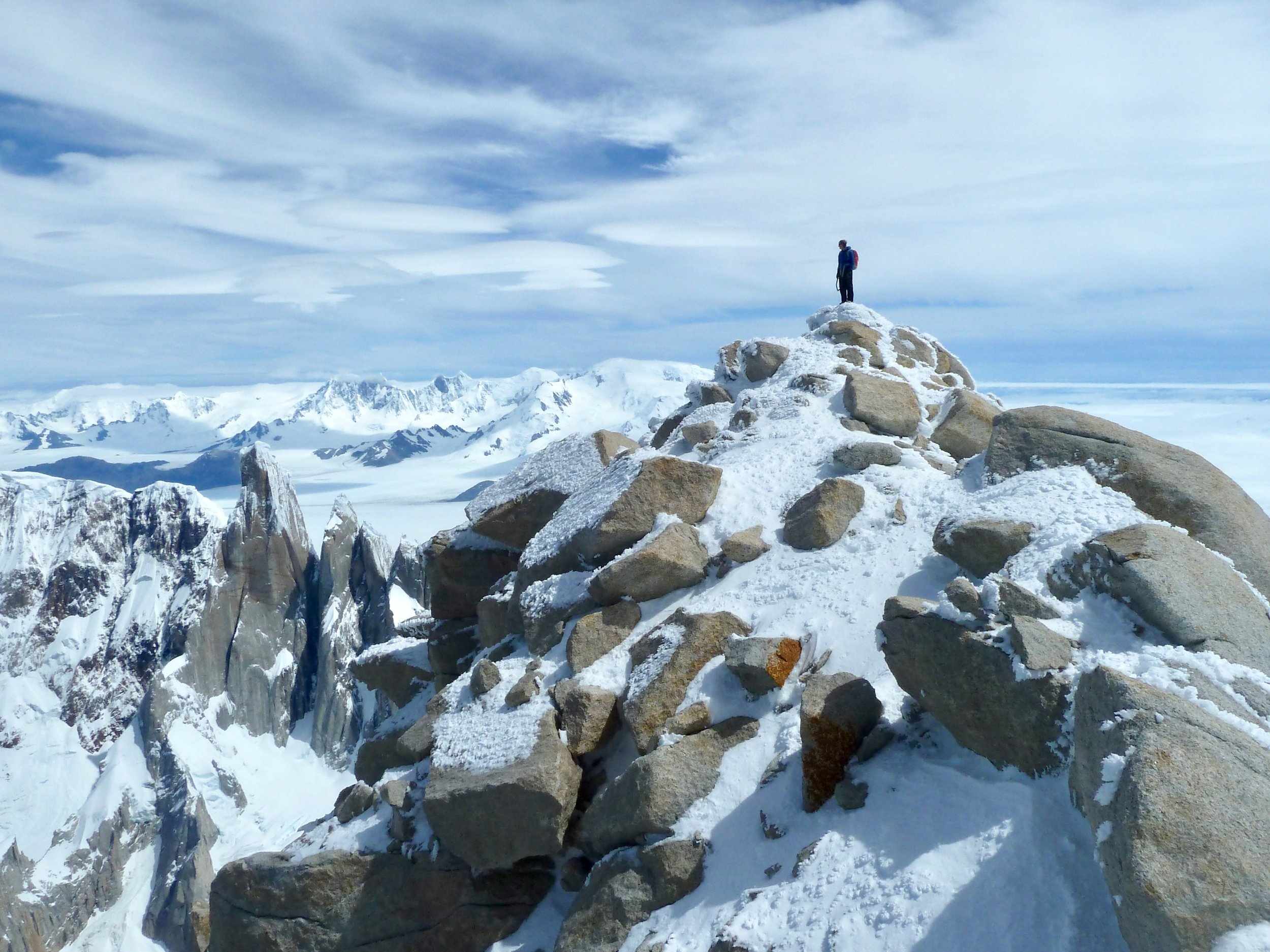tony stone on the summit of fitzroy. patagonia.