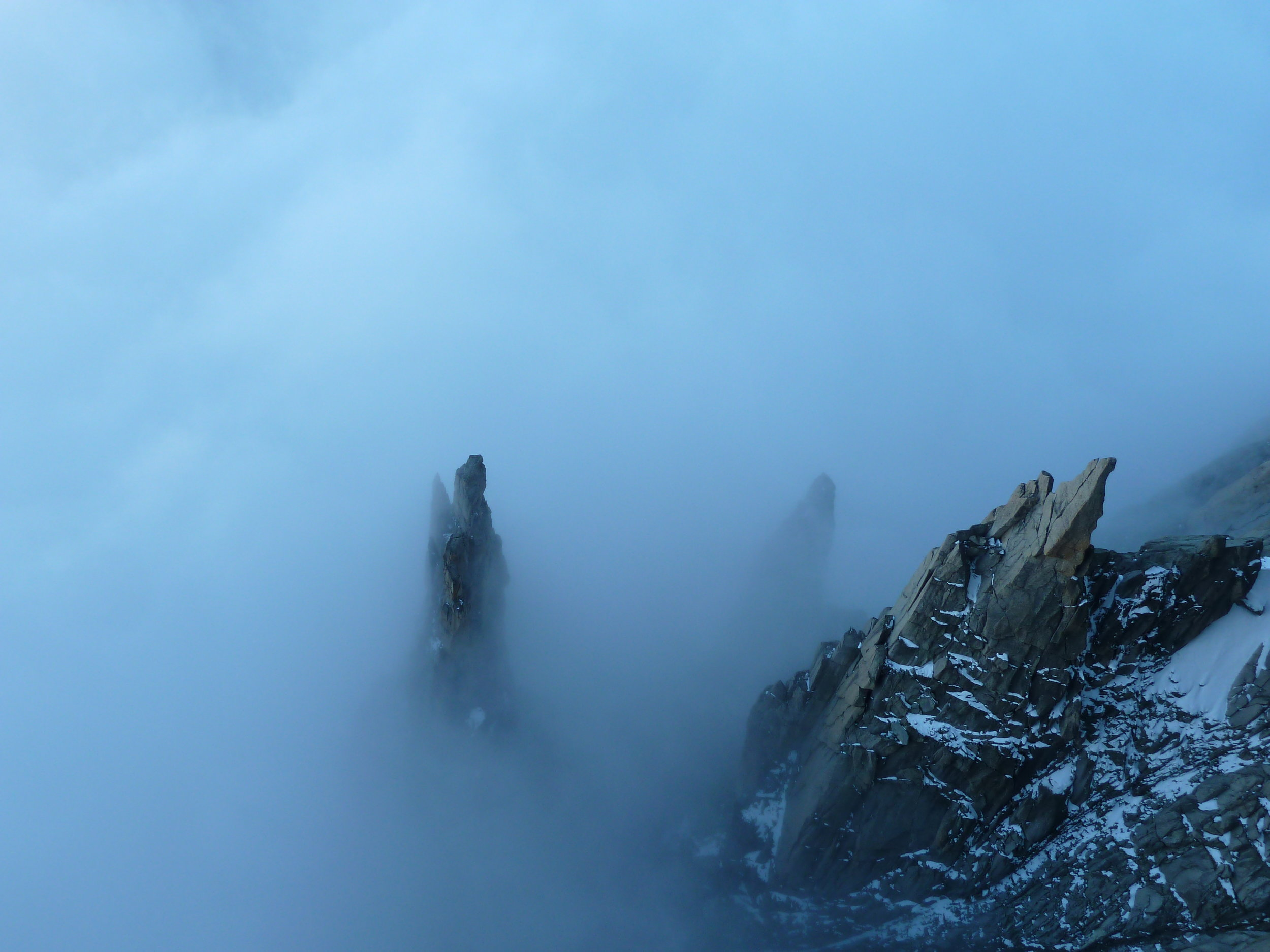 spires in the clouds. grand capucin, mont blanc massif, chamonix