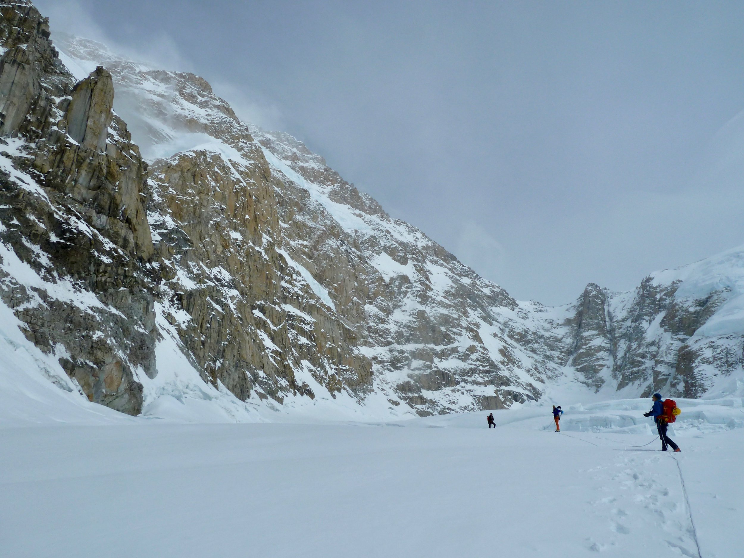 Walking out the East Fork, away from the south face and Slovak Direct of Denali. Storms raging.