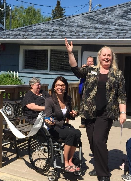 Success! - Executive Director Sharon Welch and MLA Michelle Stilwell celebrate the completion of Phase Two with a Toilet Paper Cutting Ceremony!