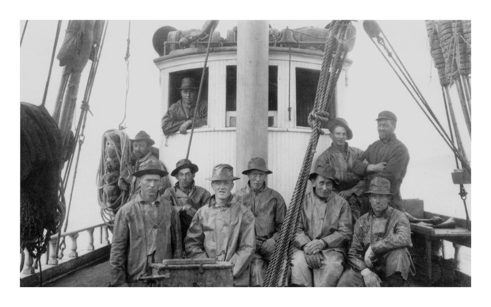 crew-on-deck-in-raingear-front-of-wheelhouse_bw_4x6-300dpi.jpg