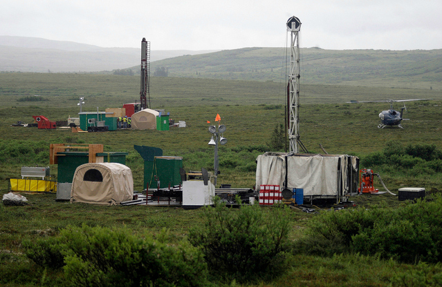 In this July 13, 2007 file photo, workers with the Pebble Mine project test drill in the Bristol Bay region of Alaska near the village of Iliamma. A Canadian company that was courted as a potential partner in a proposed copper-and-gold mine near one of the world's largest salmon fisheries has backed away from the project. Mine developer Northern Dynasty Minerals Ltd. says it was unable to finalize an agreement with First Quantum Minerals Ltd., the potential investor. The proposed mine is near Alaska's Bristol Bay, which is where about half the world's sockeye salmon is produced. (AP Photo/Al Grillo, File)