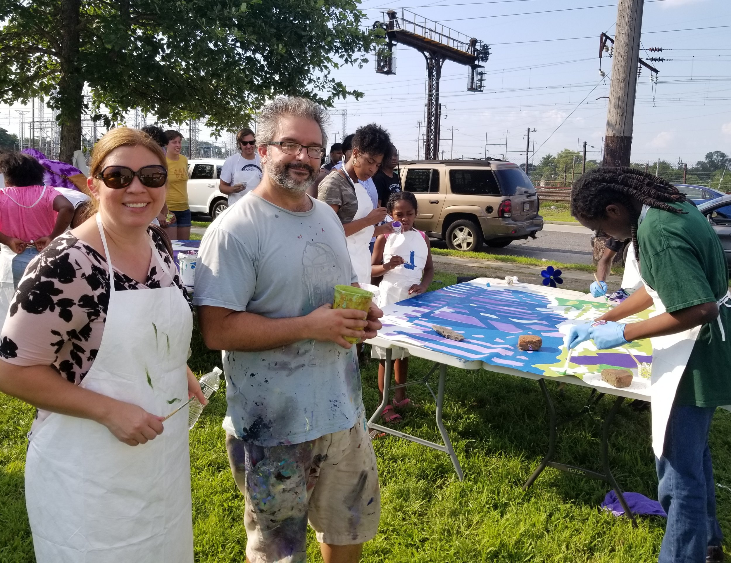 Dr. Adriana Torres-O'Connor CEO and Mural Artist Eric Okdeh
