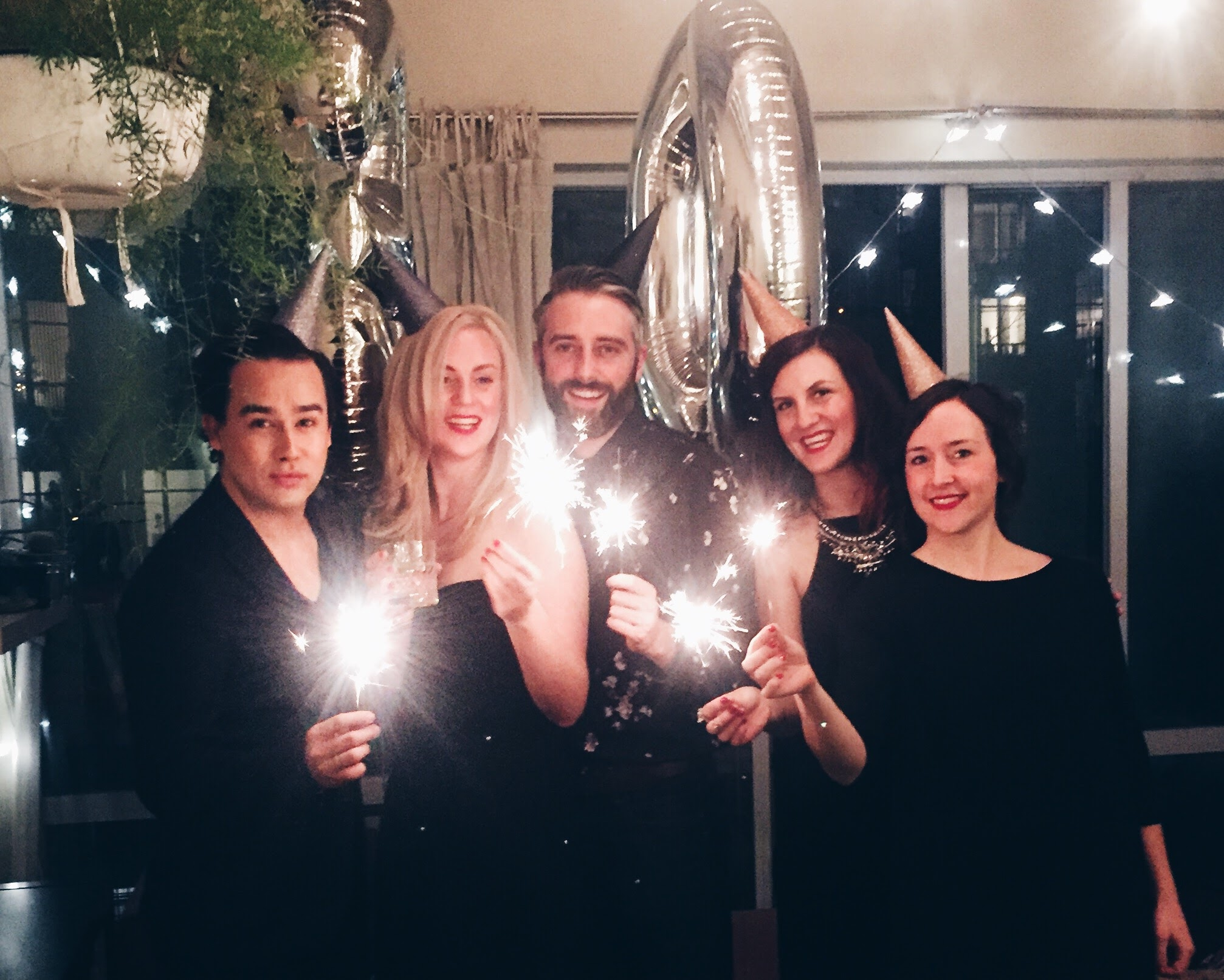 DIY metallic ombre glitter party hats for a classy 30th birthday + balloons + sparklers