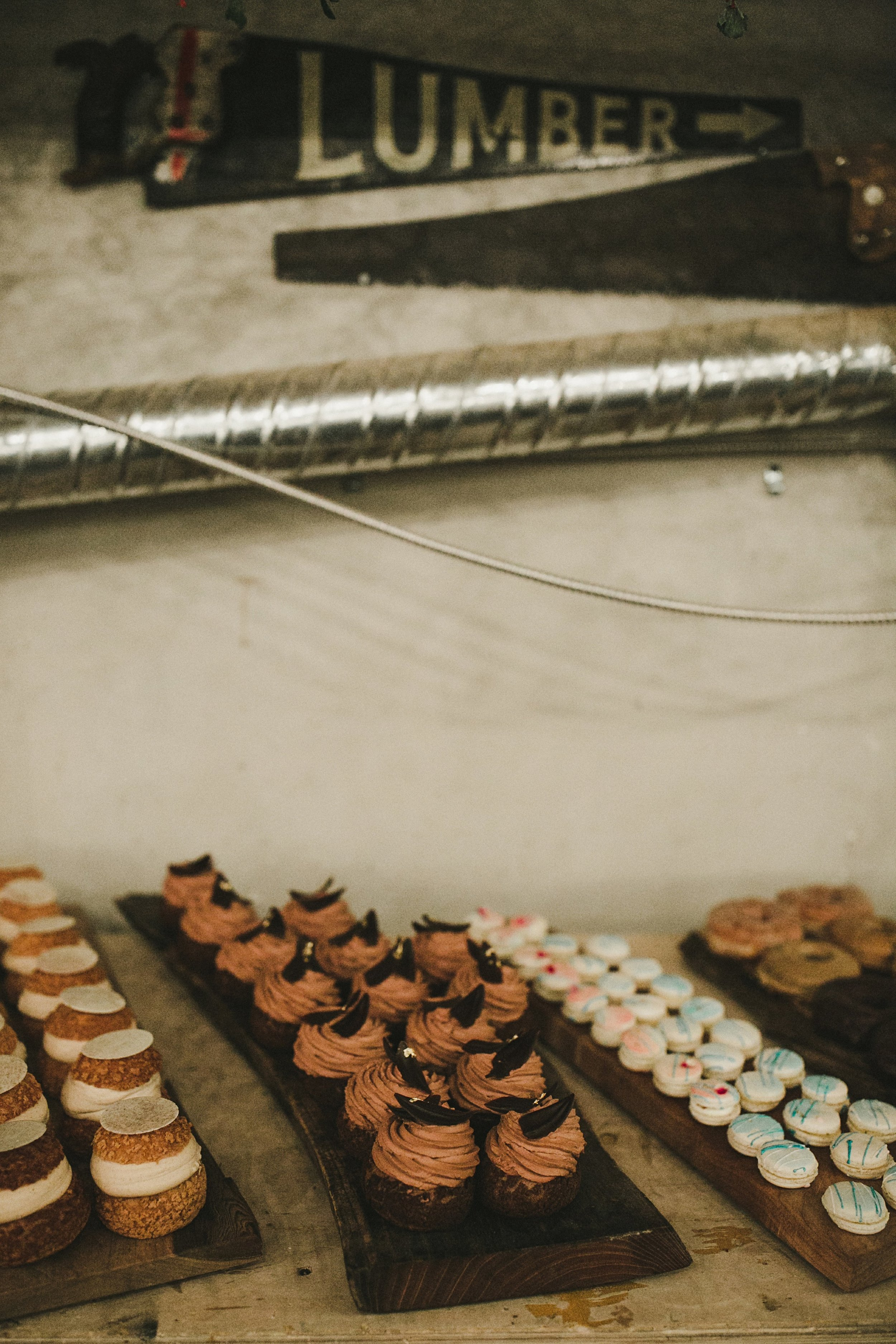 HOWE ABOUT FOREVA - Vancouver urban woodshop wedding by Shari + Mike photographers - Beta 5 cream puffs + Livia Sweets macaroons