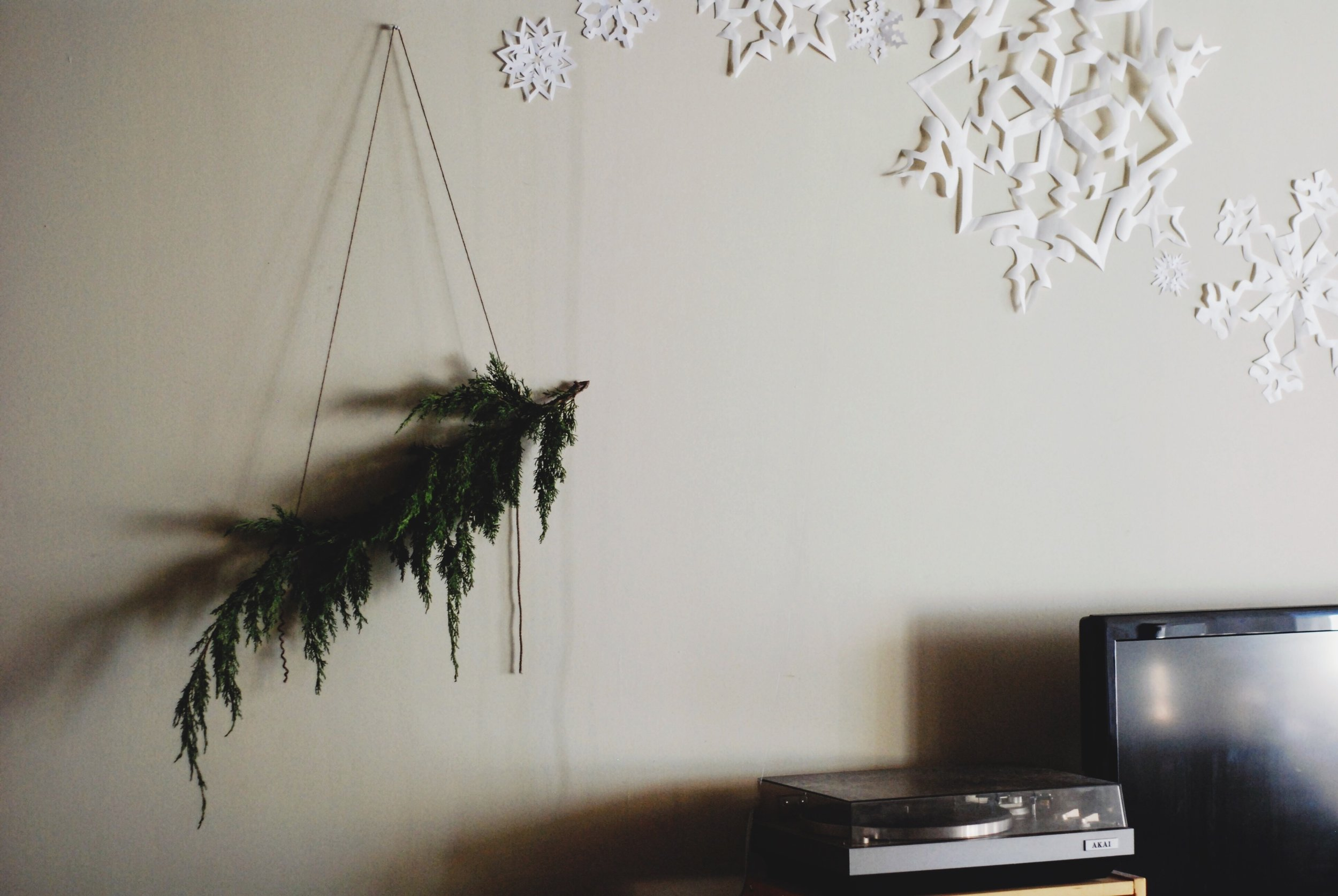 DIY Giant Snowflake wall decor for the holidays how to hang a paper snowflake