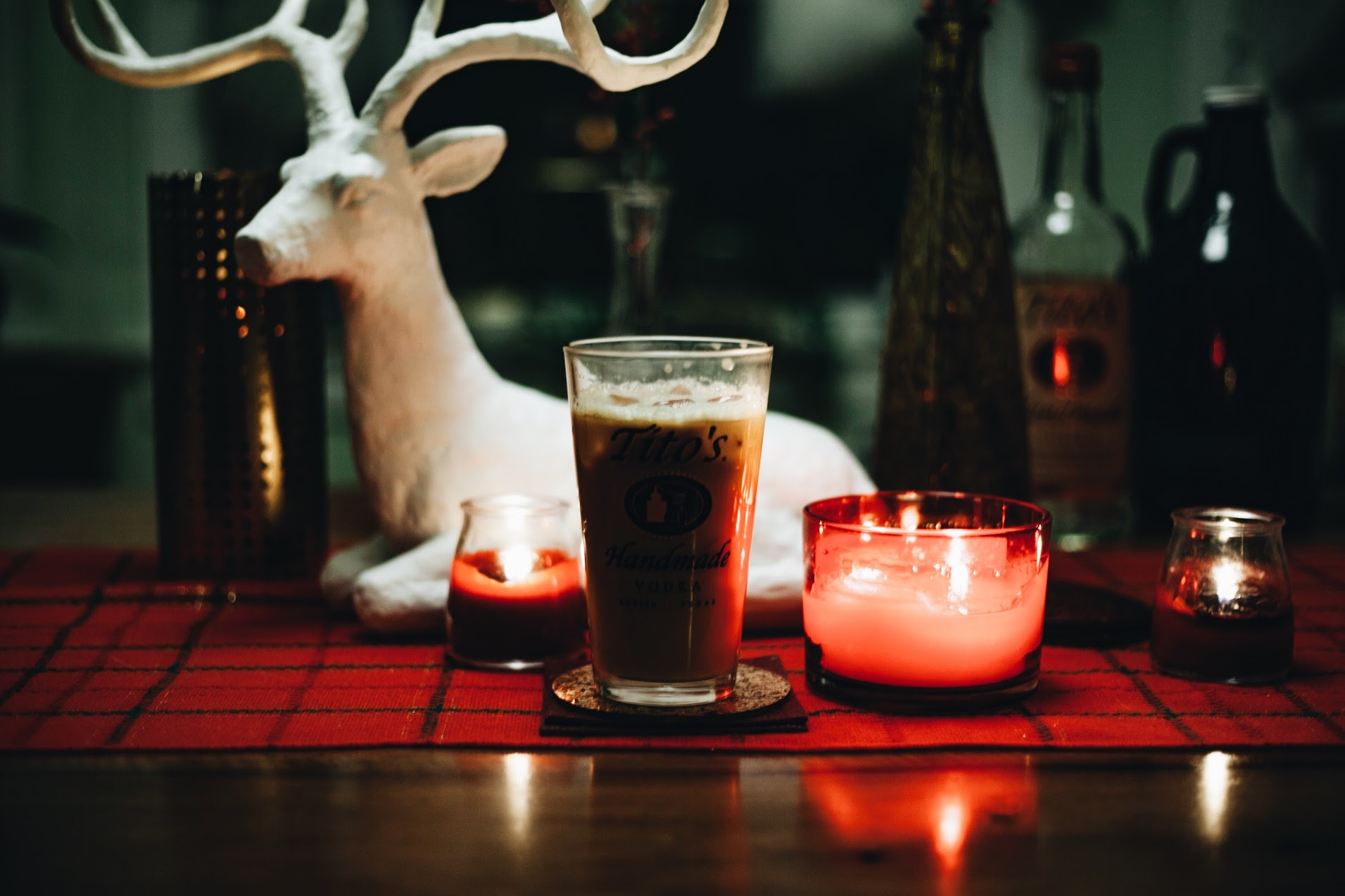 Tito's Iced Coffee White Russian - 2 oz. Tito's Handmade Vodka1 oz whole milk or heavy cream1 oz Thou Mayest Iced Coffee concentrate (fully mixed)Ice